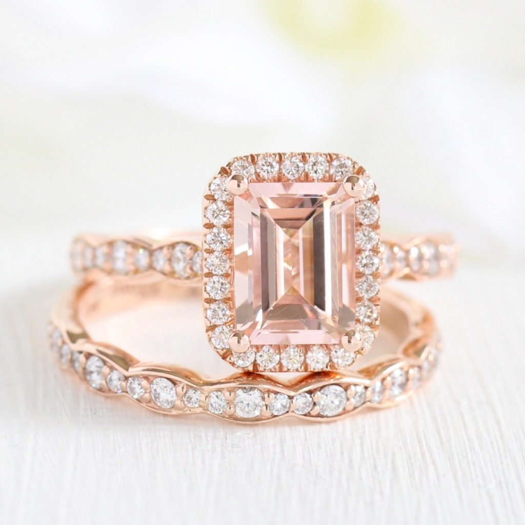 How sweet she is ~ This Halo Emerald Cut Morganite Bridal Set in Scalloped Diamond Band has us with hearts in our eyes! See more of