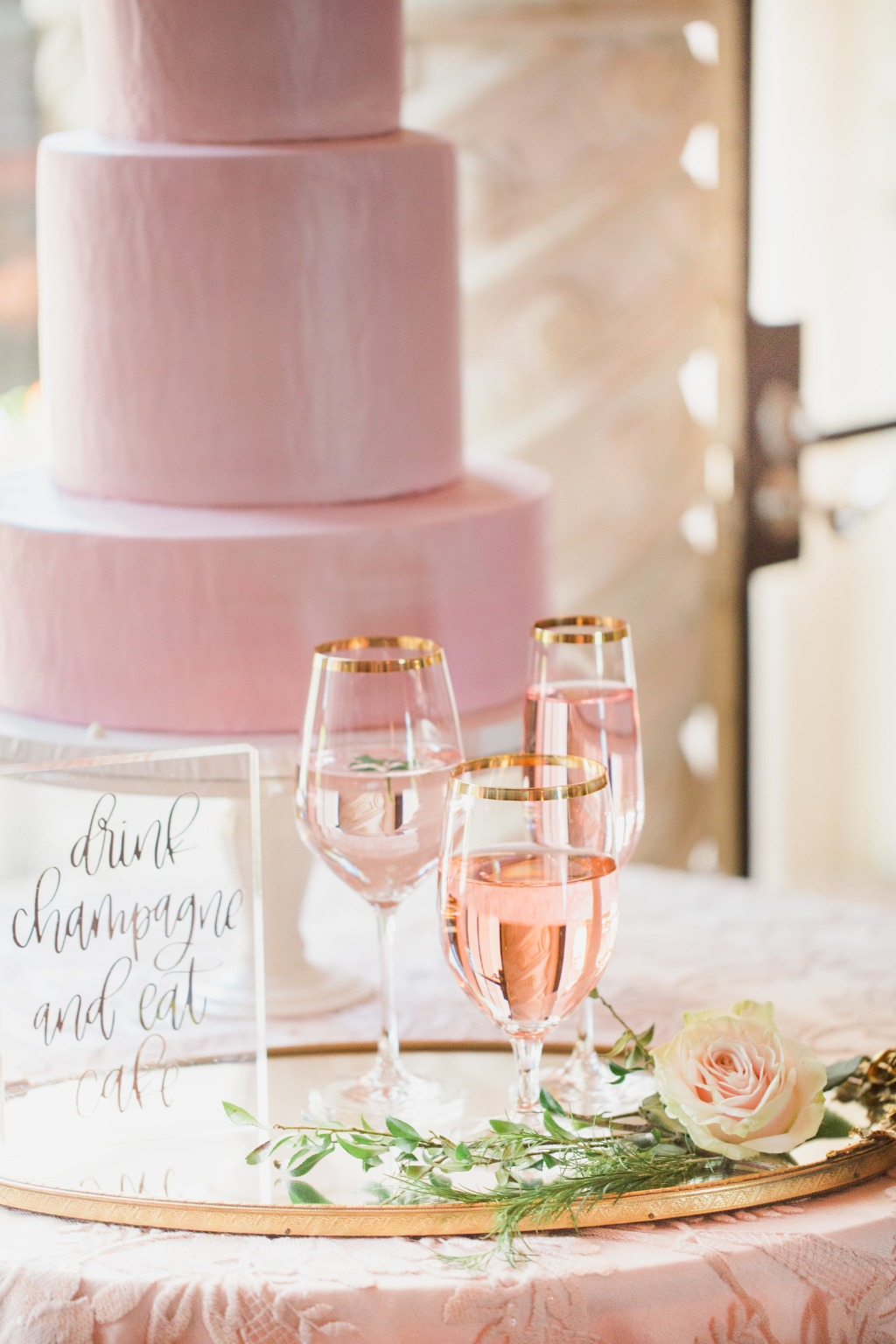 A wedding day to-do: Drink champagne and eat cake!