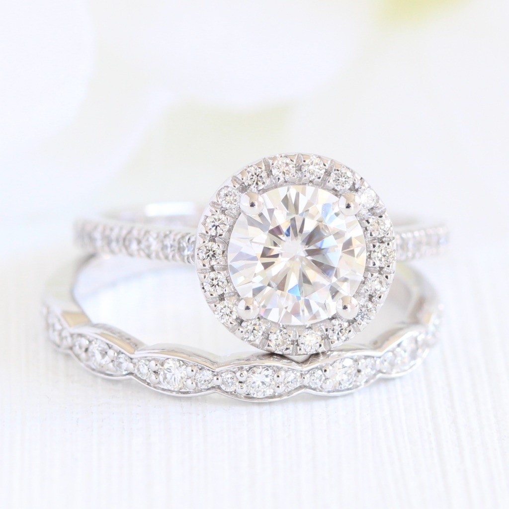With so many unique designs and styles, sometimes it's nice to bring it back to classics like this round cut moissanite engagement