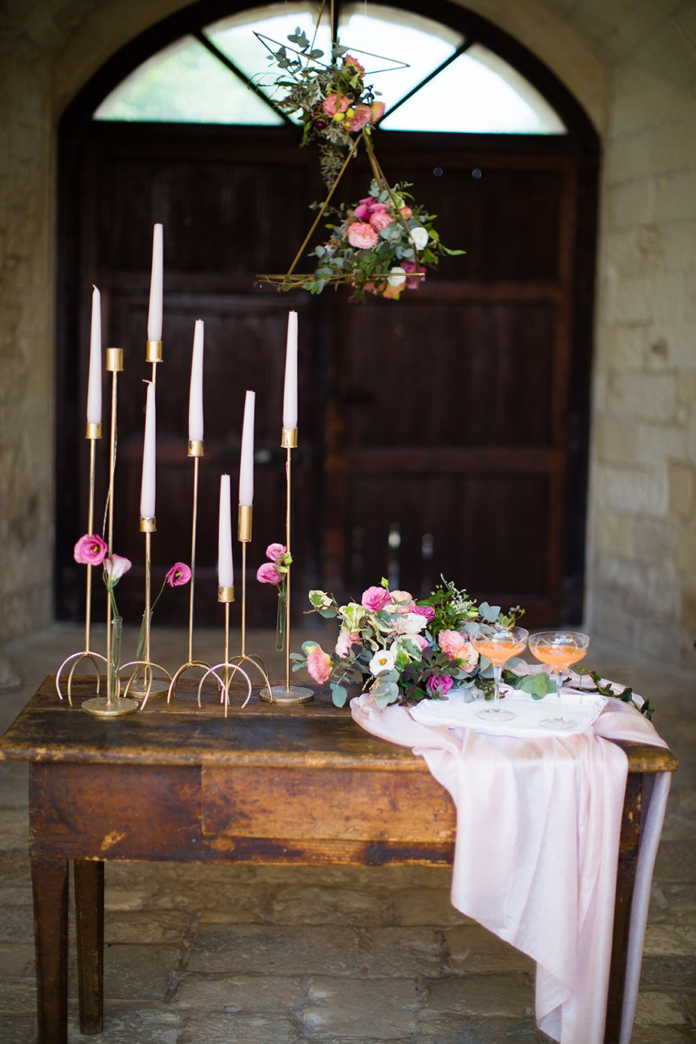 romantic floral and candle stick table decor