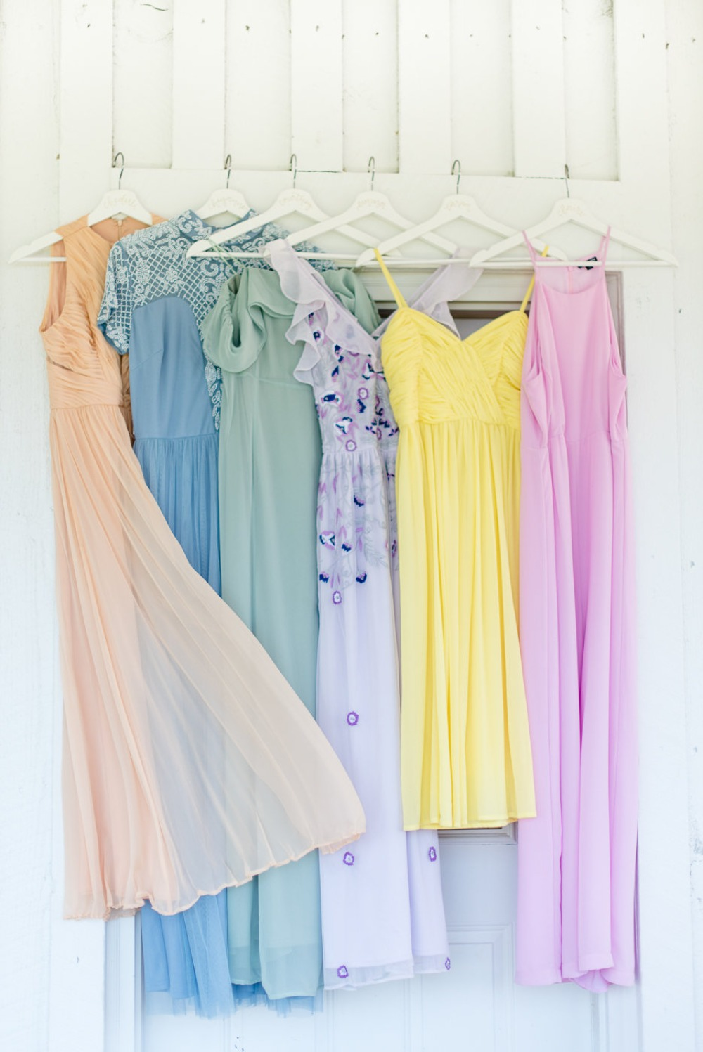 a rainbow of color bridesmaid dresses