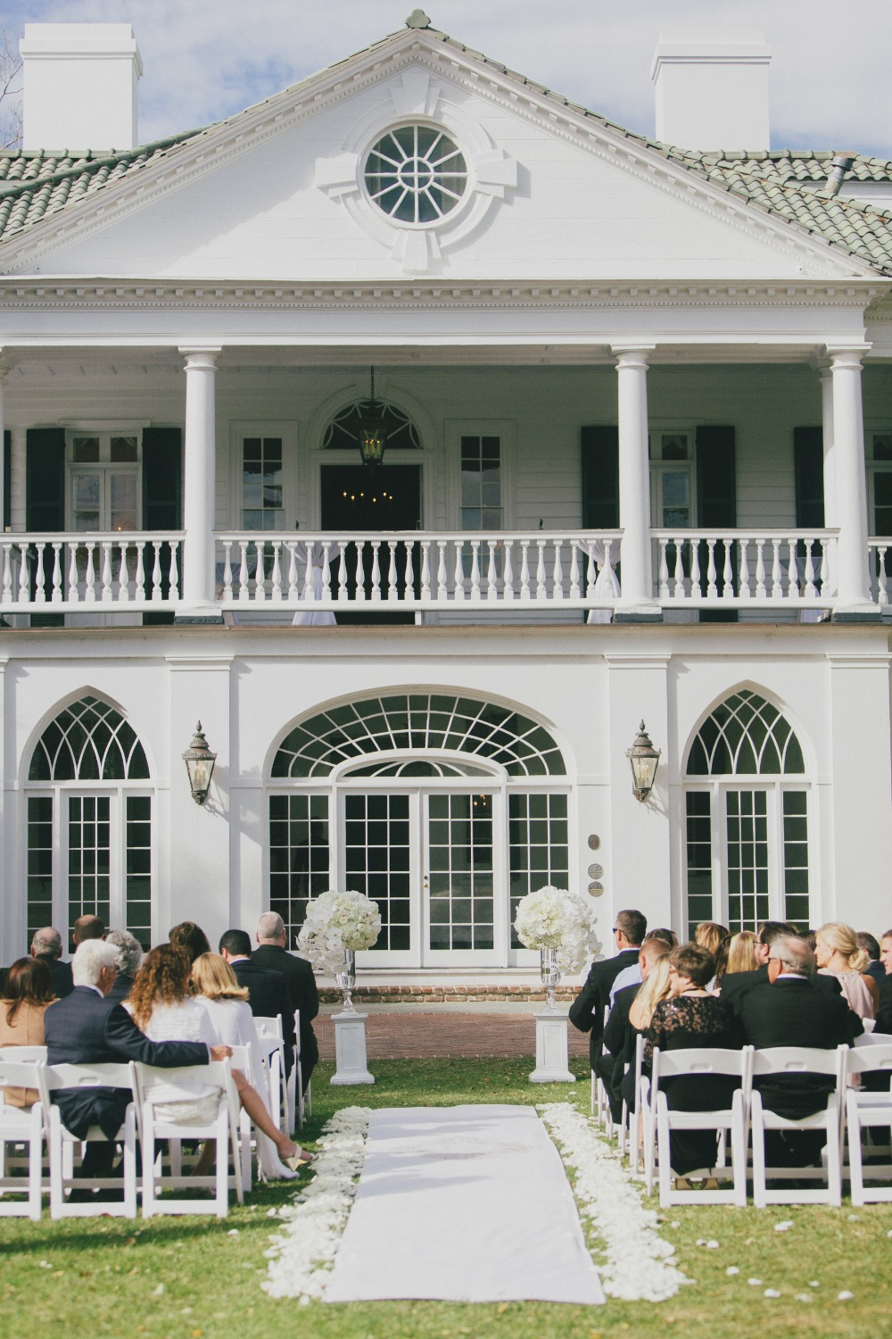 formal all white wedding ceremony outdoors