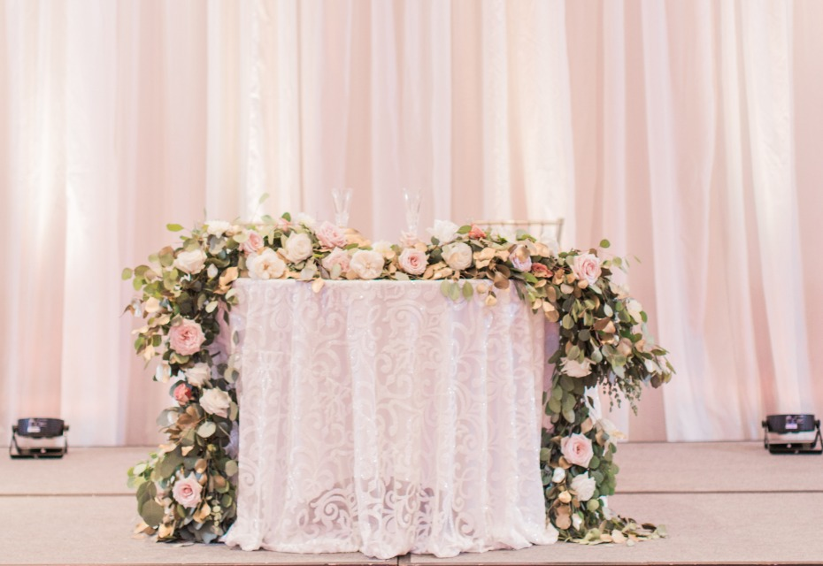 Floral garland sweetheart table decor