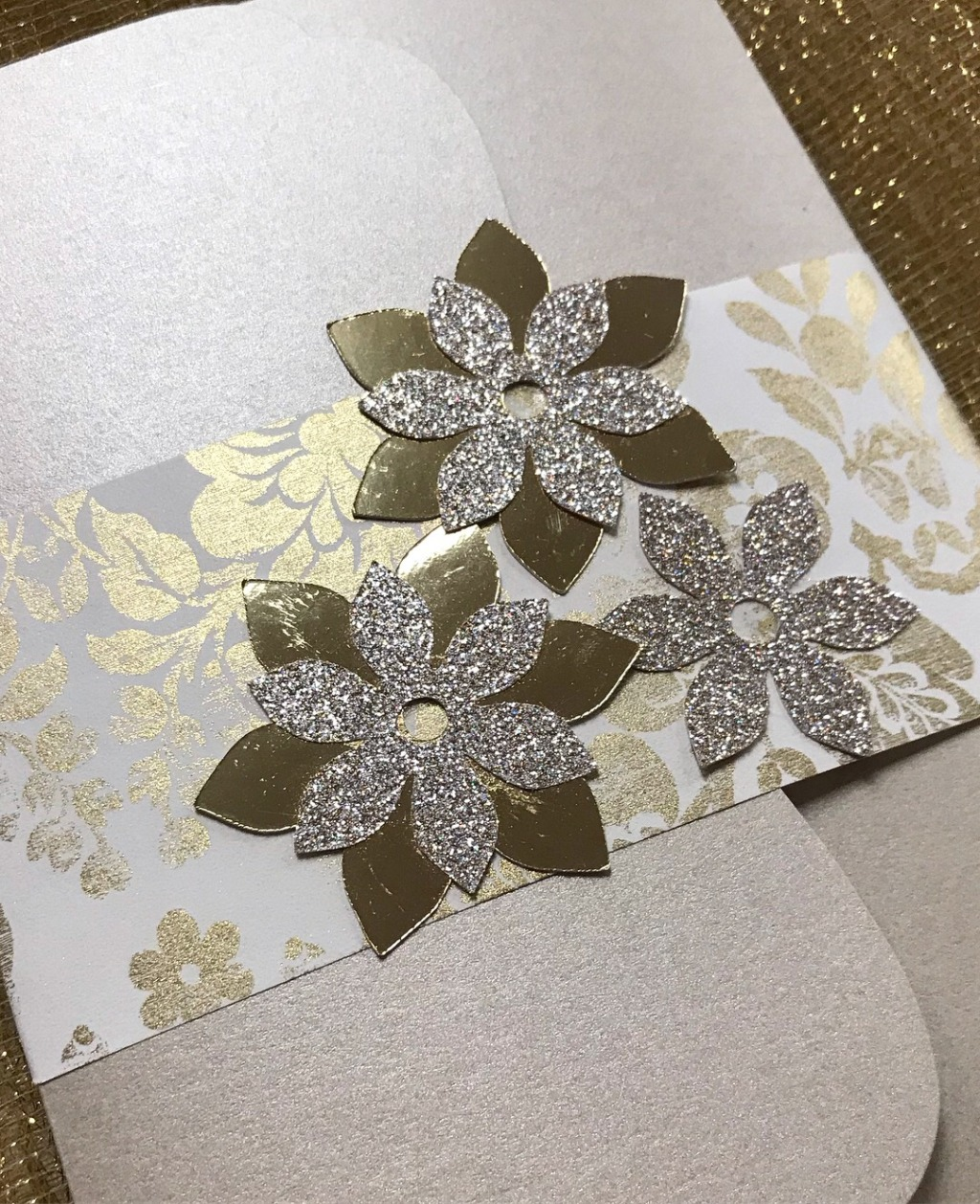 Gold foil and laser cut floral belly band designed exclusively by Persnickety Invitation Studio