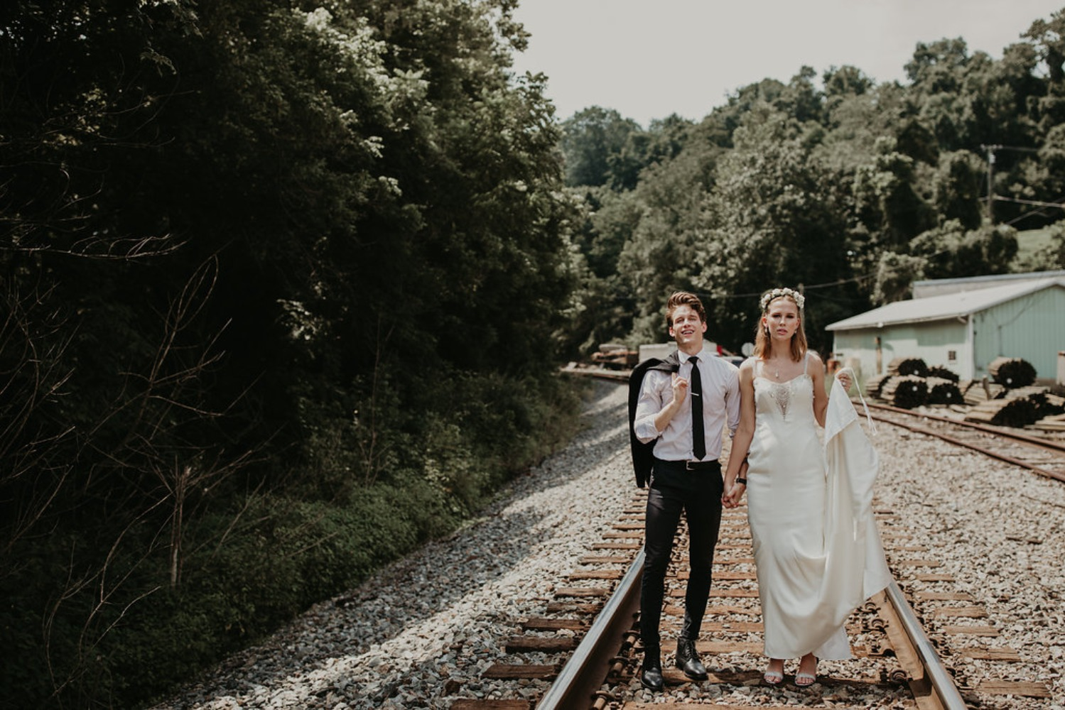 wedding couple on the train tracks