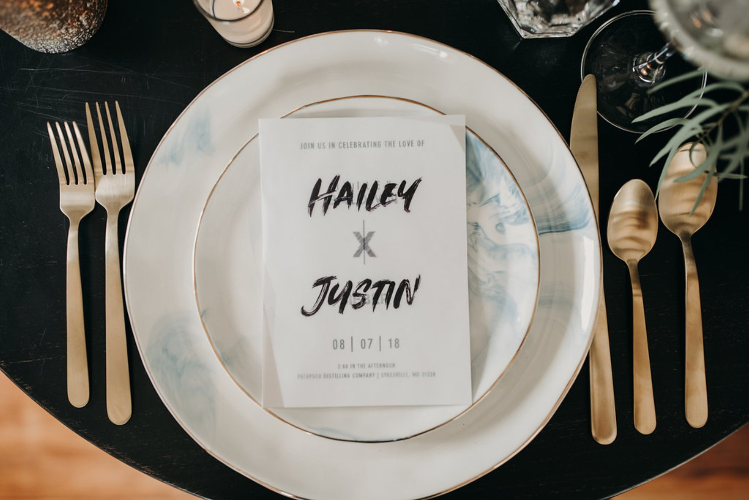 modern gold and black wedding place setting