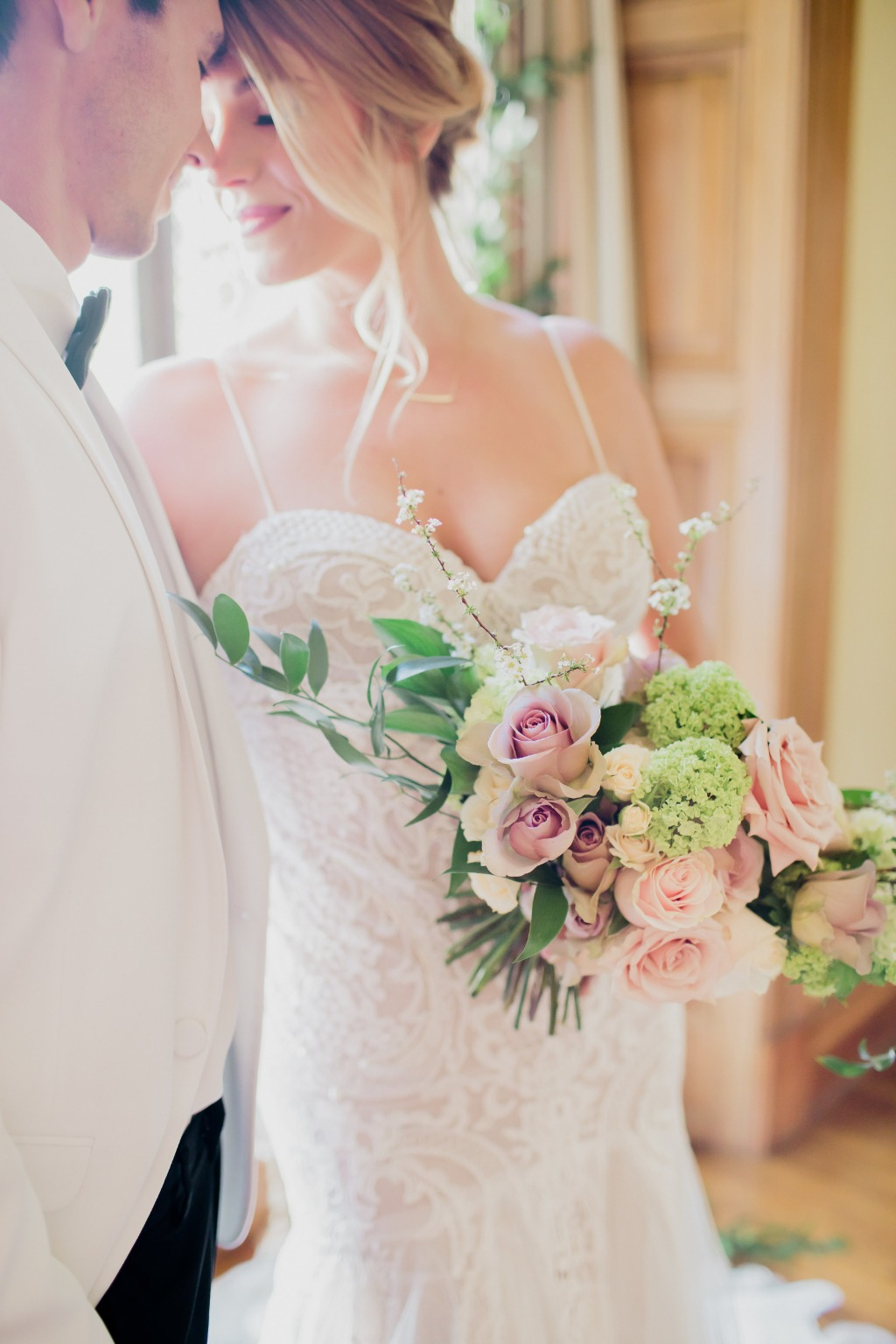 We're loving the fresh, clean look on this gorgeous bridal bouquet, with its soft, romantic roses and beautiful pops of green. Photography
