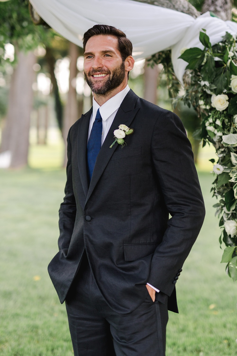 groom in black and royal blue