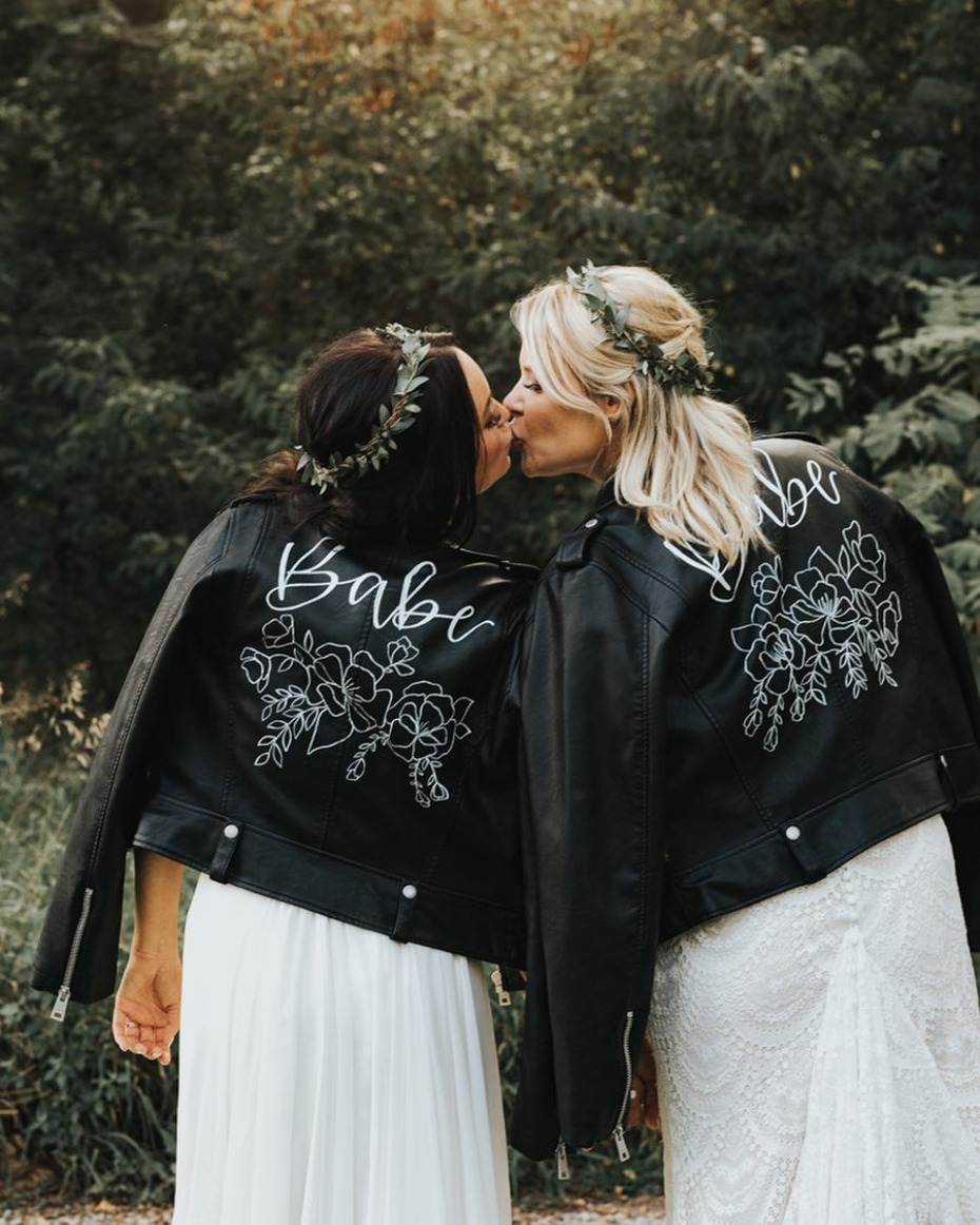 Brides in leather jacket.