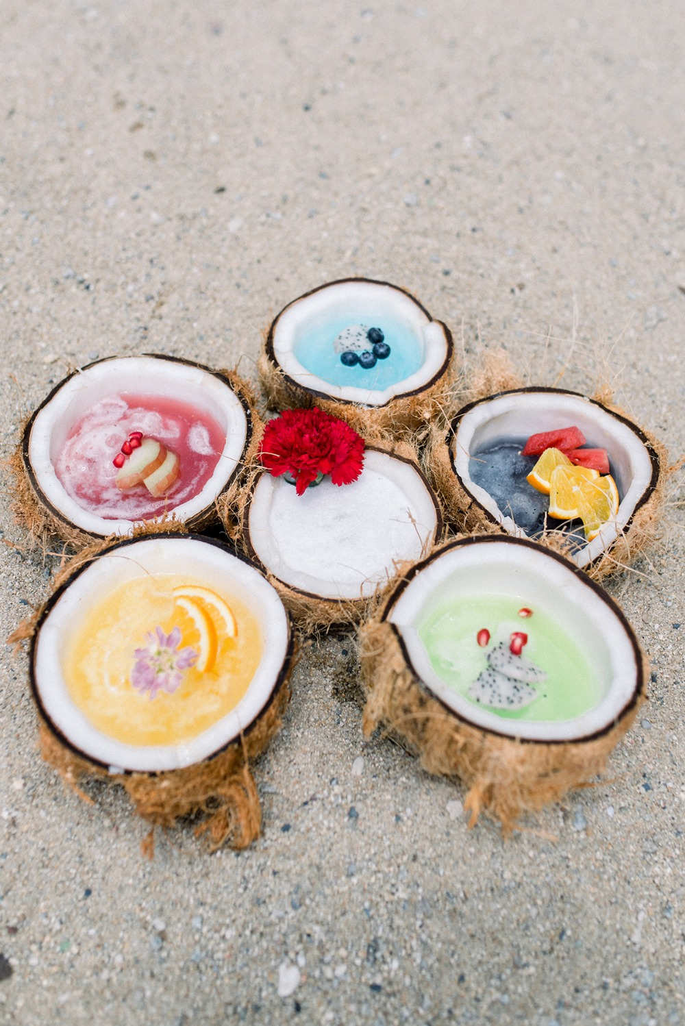 slushie cocktails in coconut shells