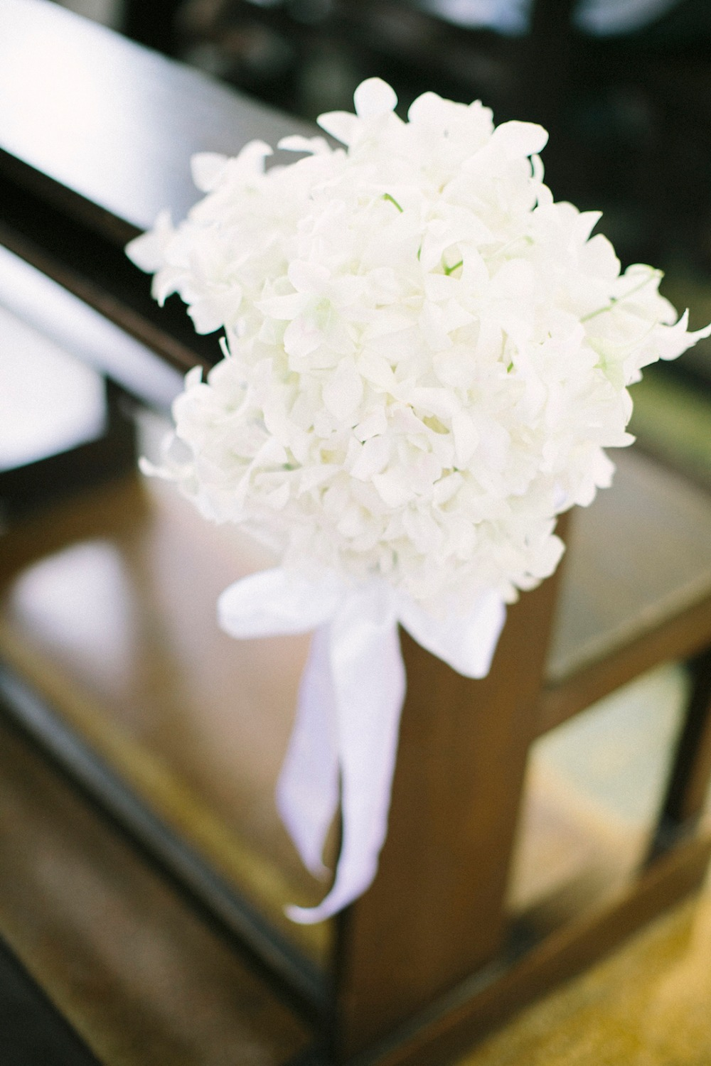 all white wedding aisle floral decor