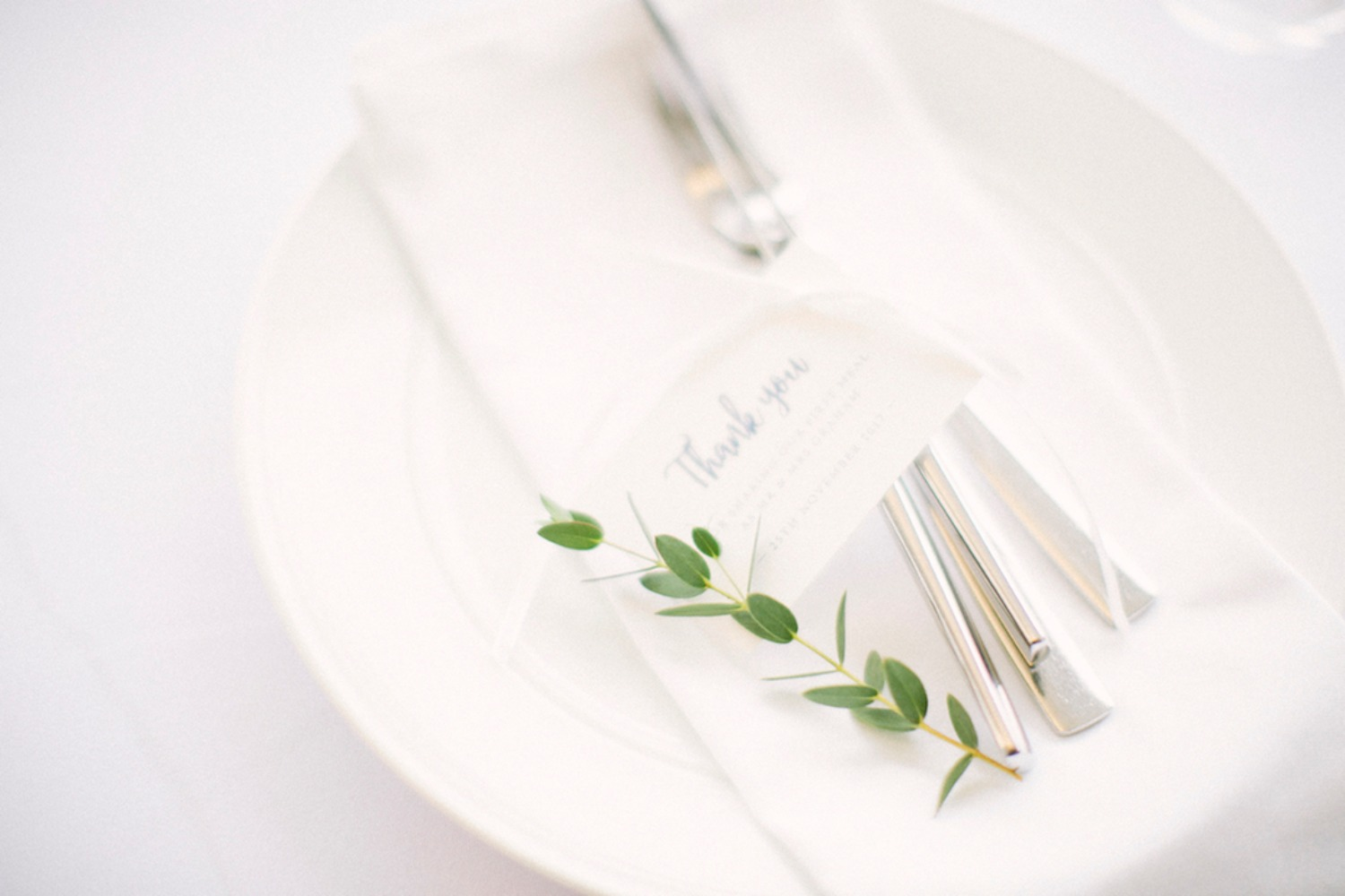 fresh white wedding place setting