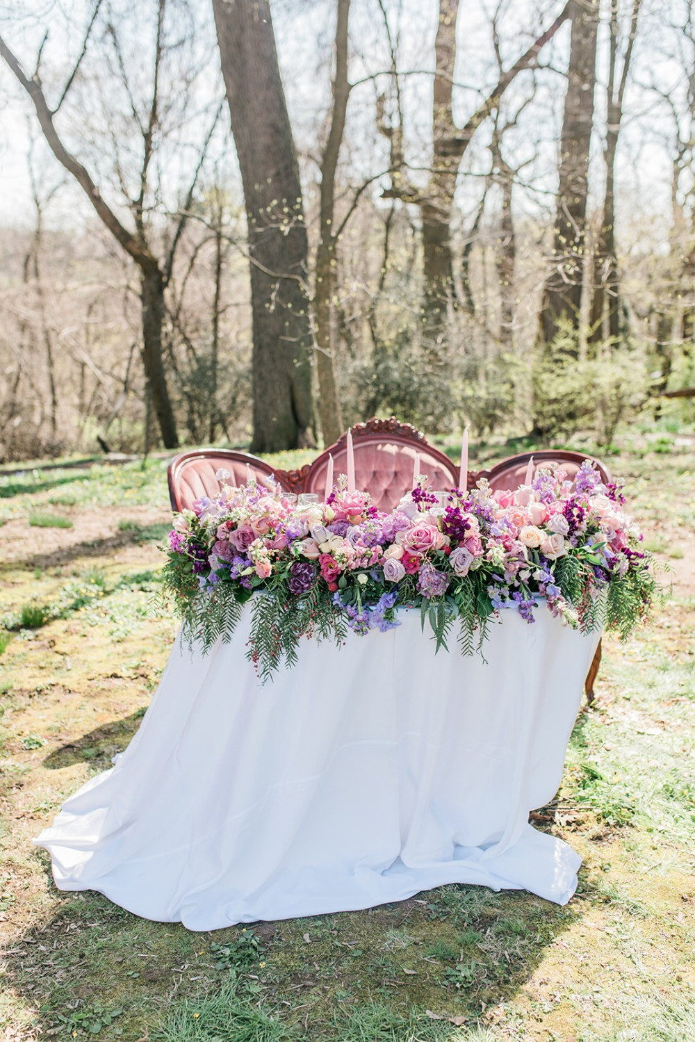 pink and purple floral accented wedding table idea