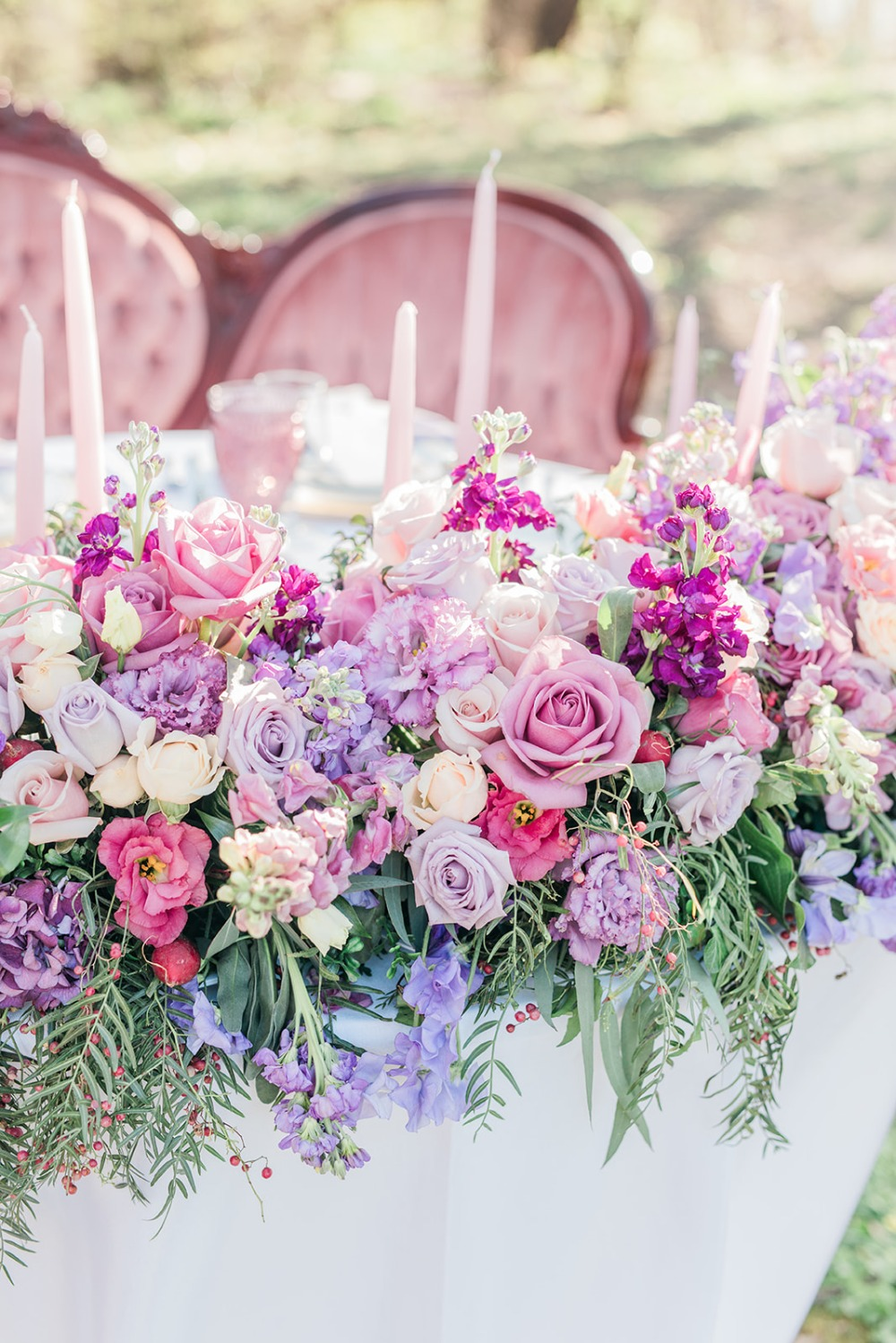 romantic pink and purple wedding flowers for your sweetheart table