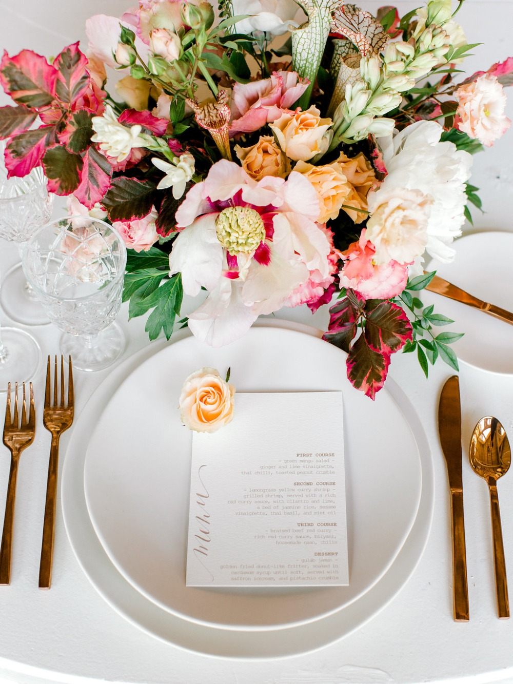 simple yet classic wedding place setting