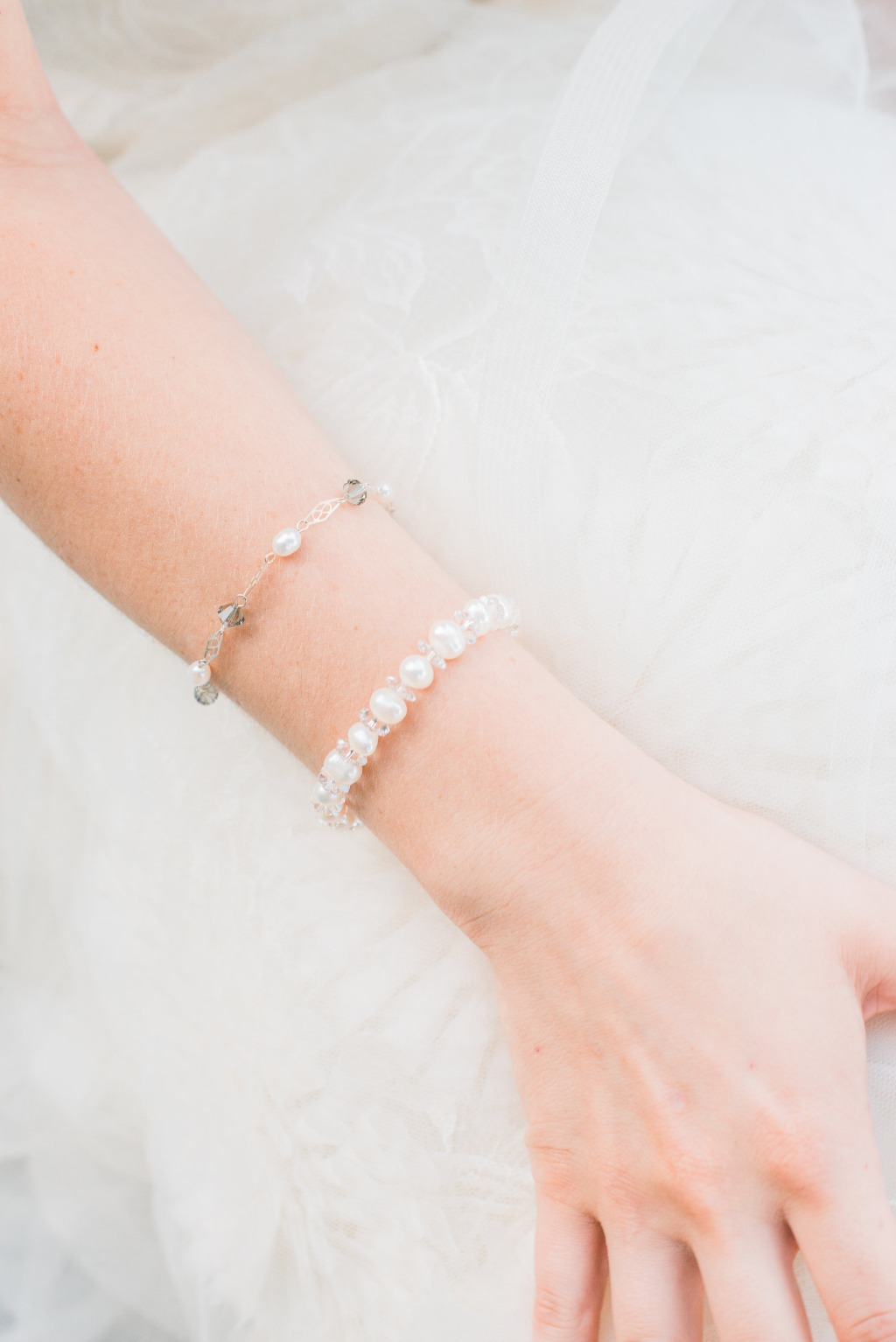 Love to stack your bracelets but don't want to look gaudy on your wedding day? Choose delicate bracelets with complementary elements