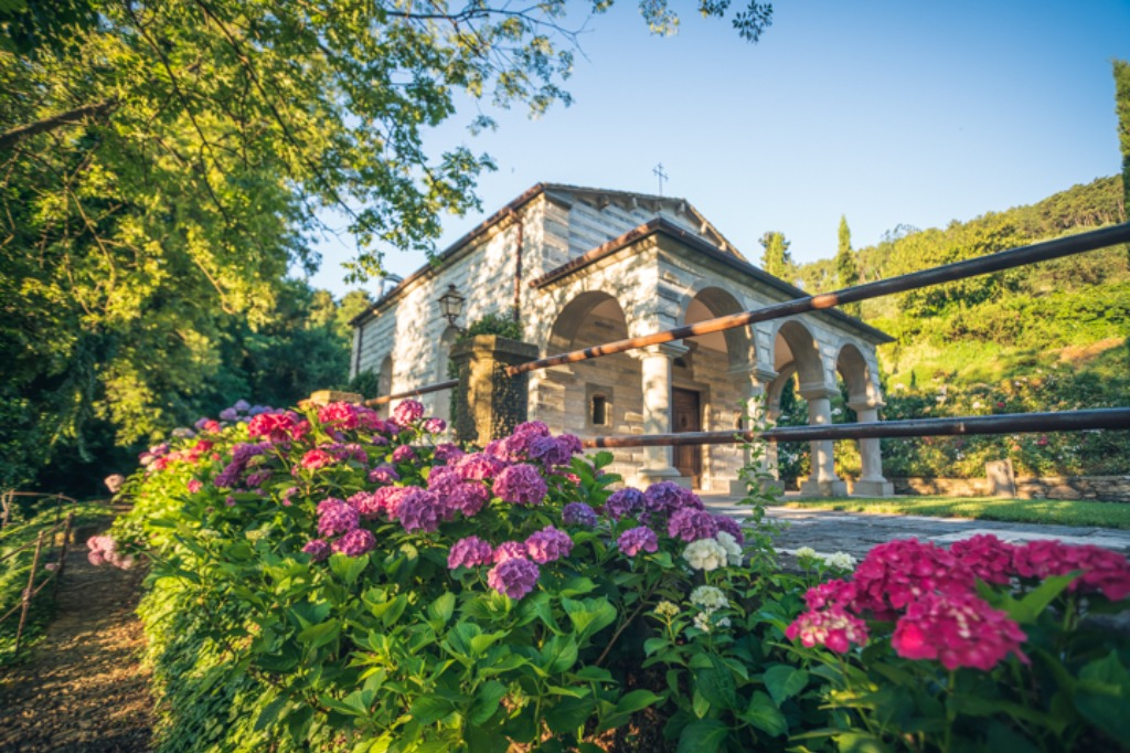 Tuscan wedding chapel surrounded by colorful hydrangeas in Spring!