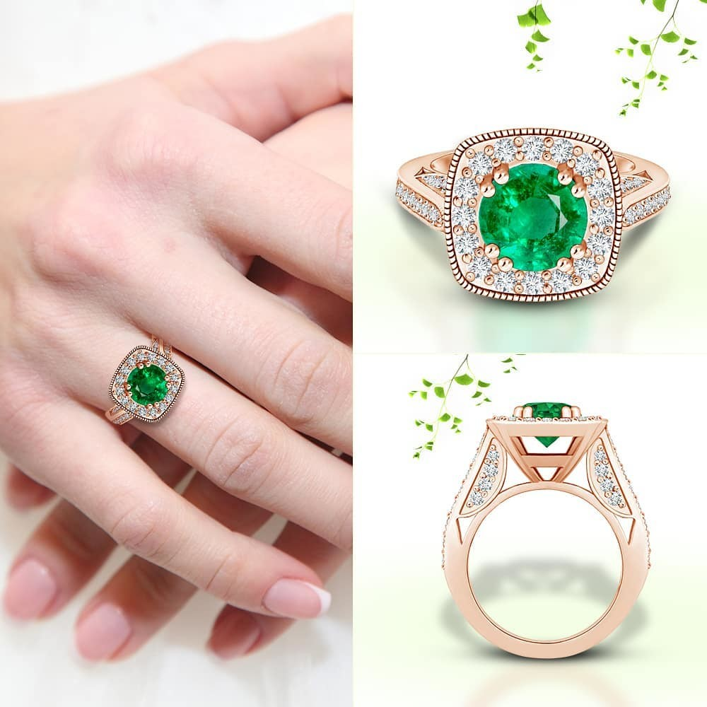 Nestled within a cushion halo, the GIA certified round emerald induces your love for green. The gem has a brilliant-cut crown and a