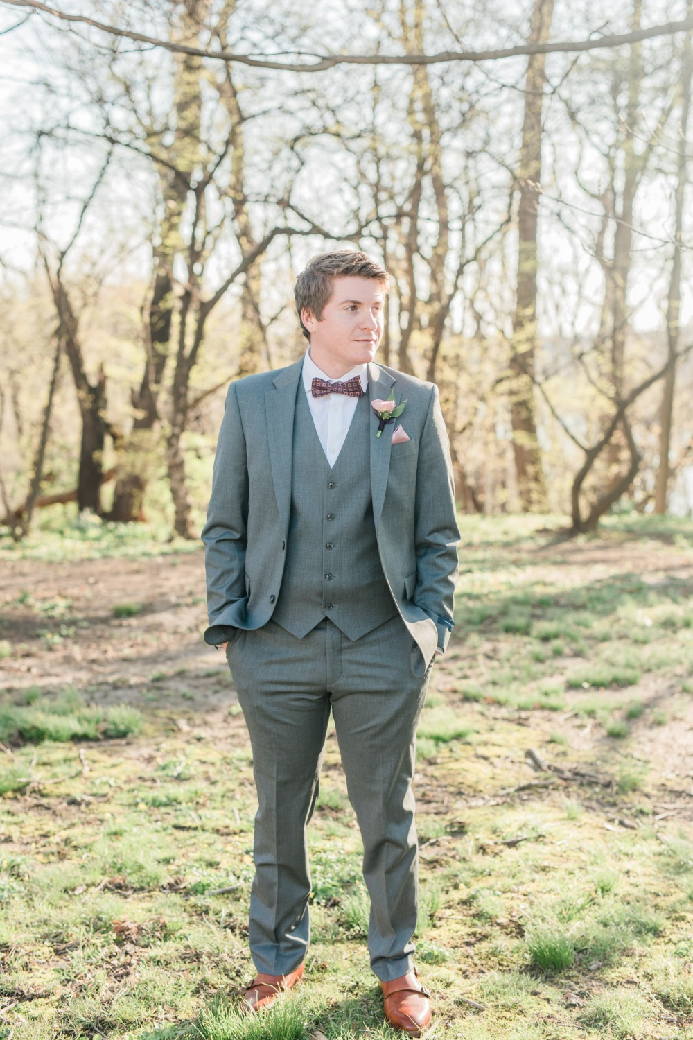 groom in three piece gray suite