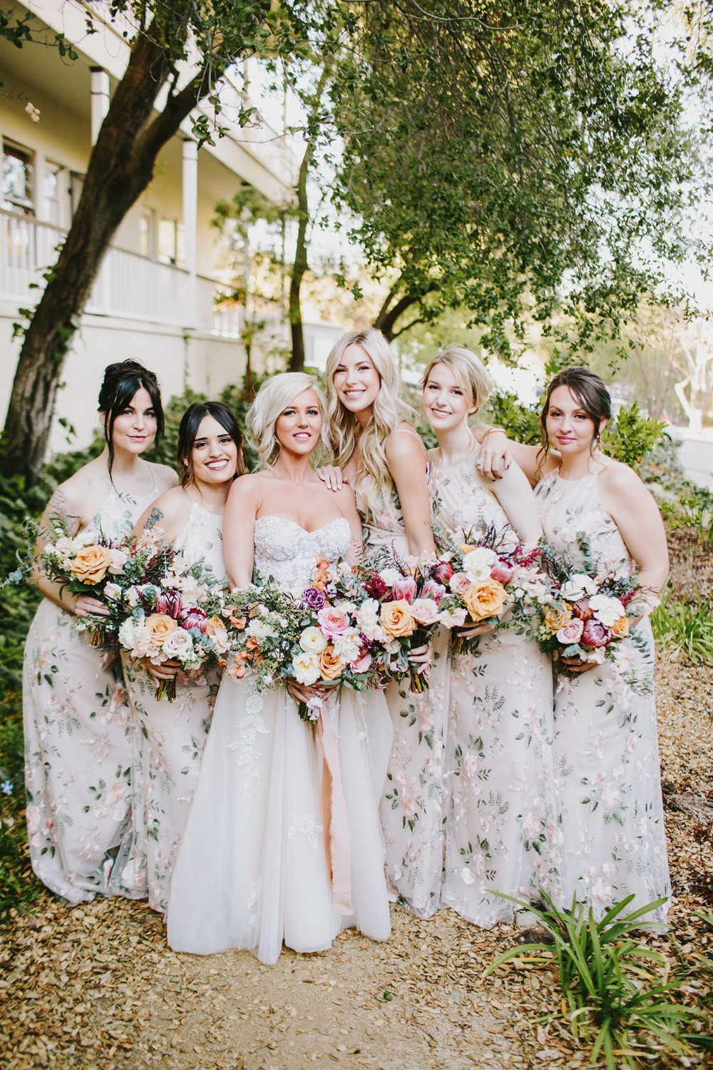 bridesmaids in floral Jenny Yoo dresses