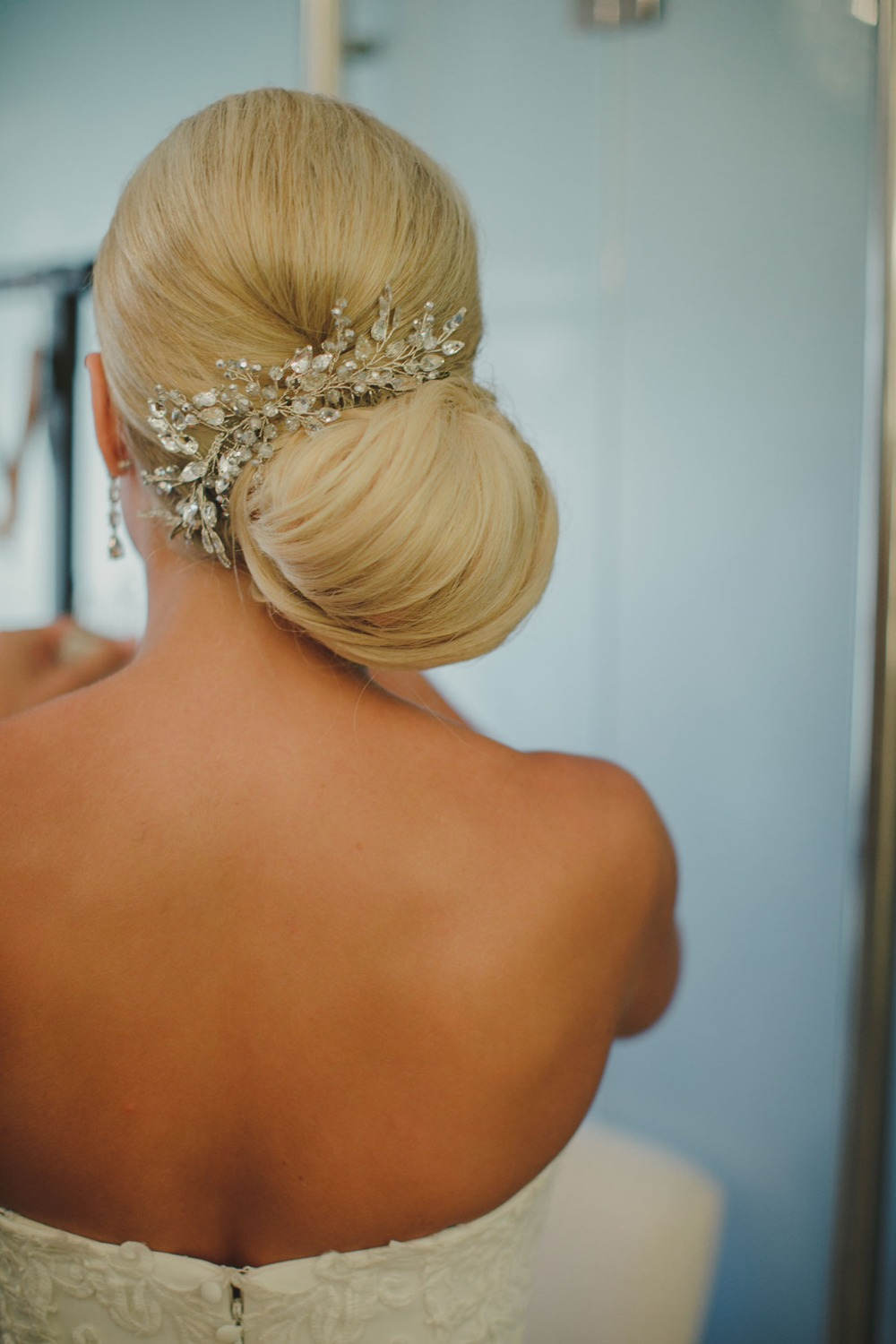 glamorous bridal up do with sparkly hair accessory