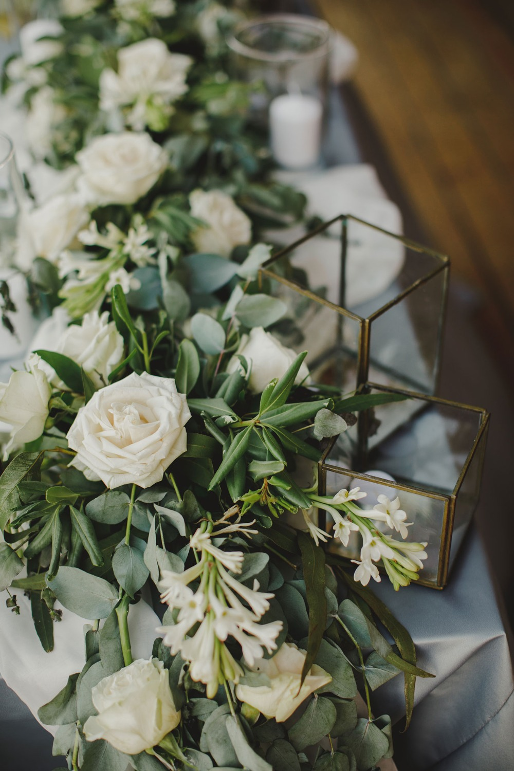 white and green florals with candles