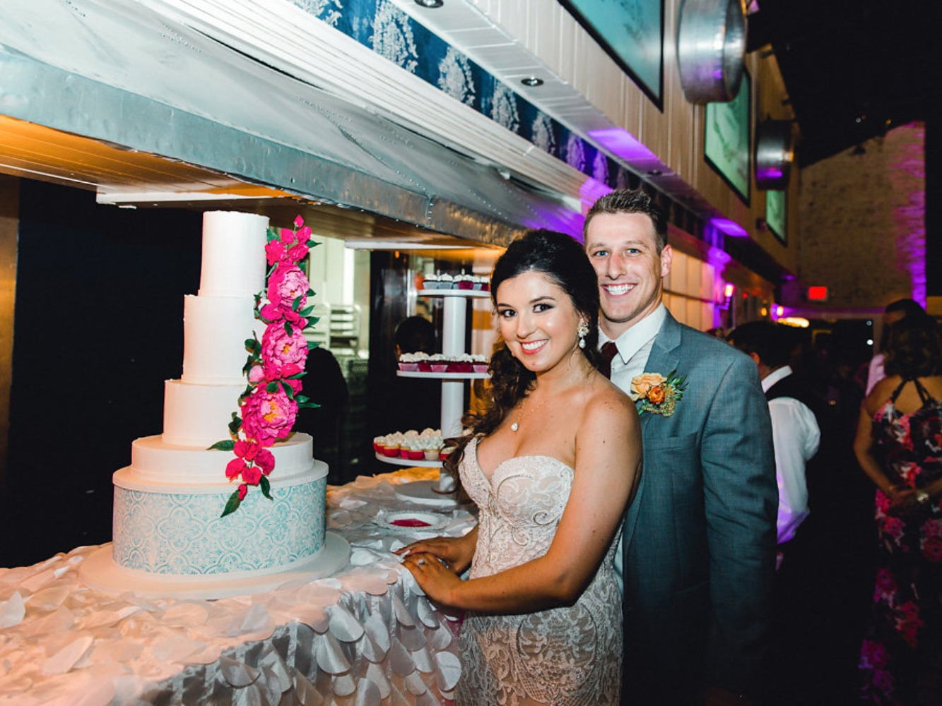 cute candid wedding couple and their wedding cake