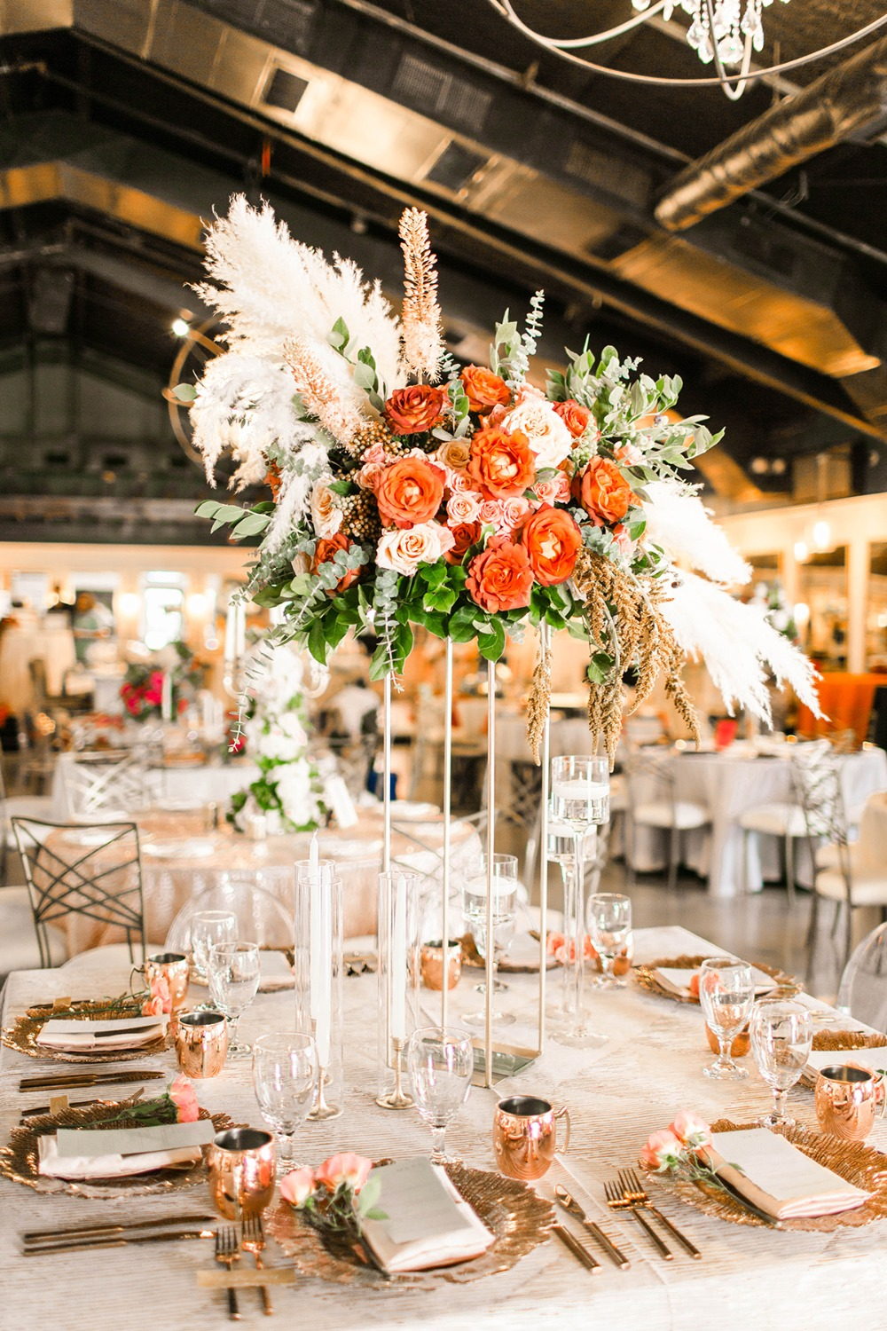 copper and gold wedding table idea with dramatic floating centerpiece