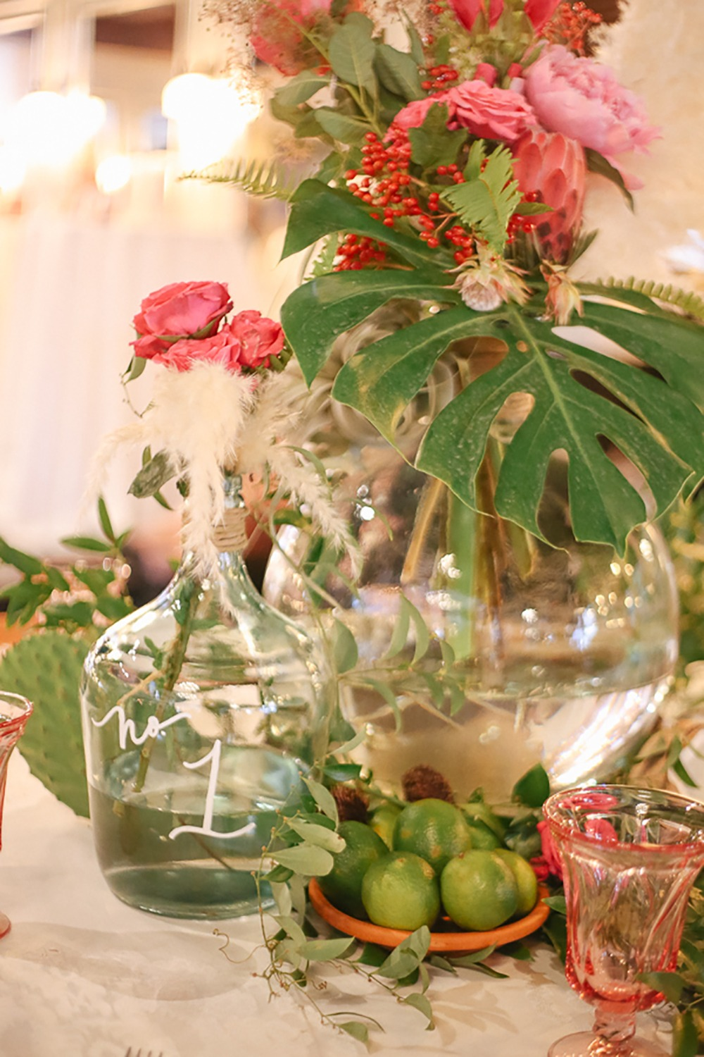 tropical and whimsical table number and centerpiece idea