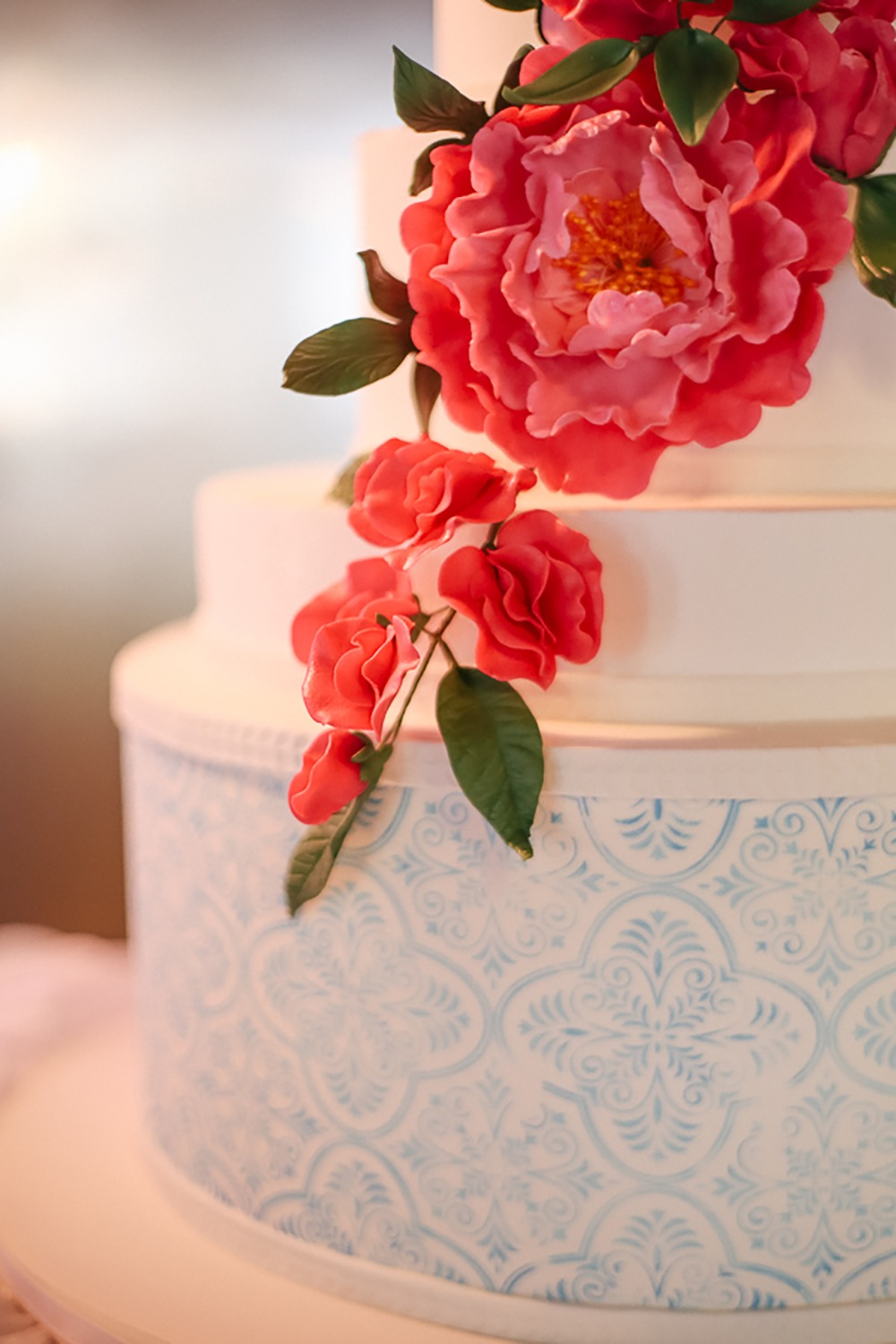 stamped wedding cake with flower accents
