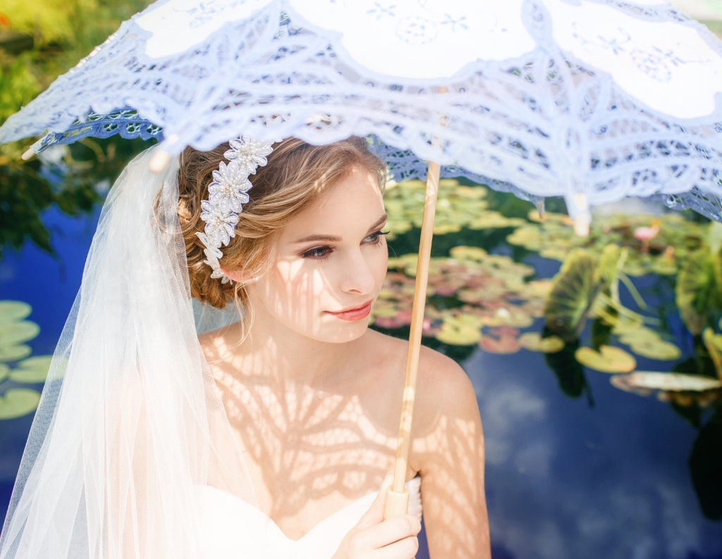 Make your bridal statement with a gorgeous Ivory and beaded bridal headpiece.