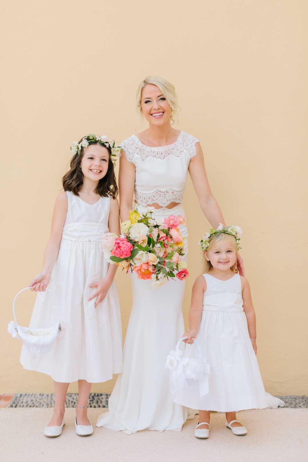 bride with her cute little flower girls