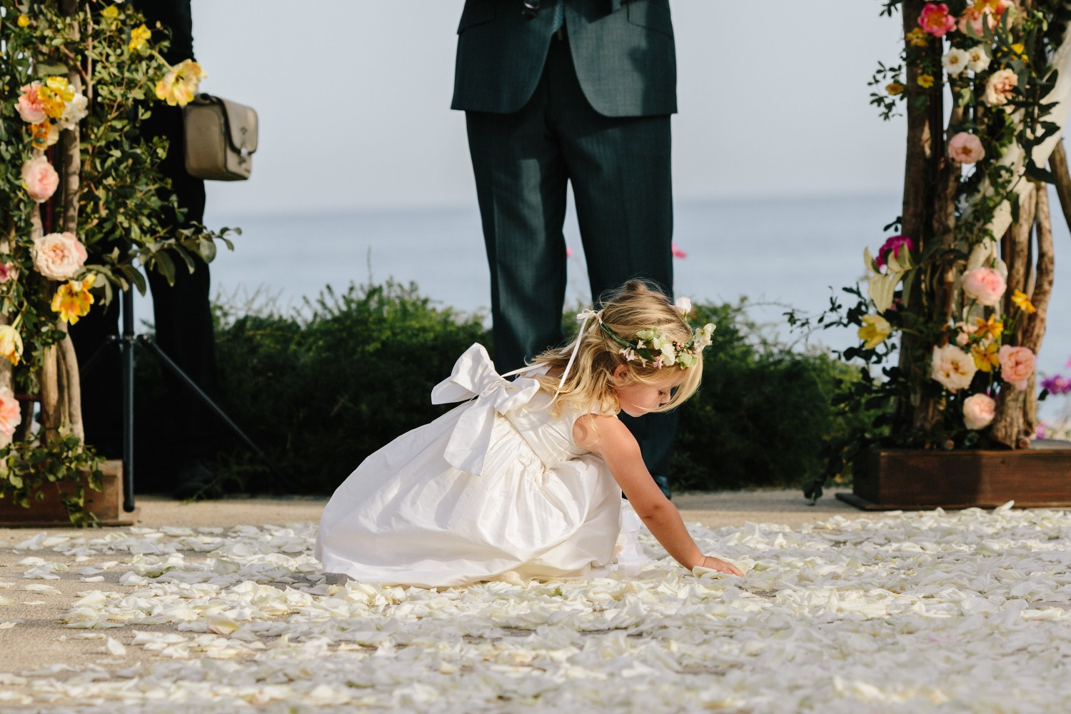 flower girl playing with the flower petals