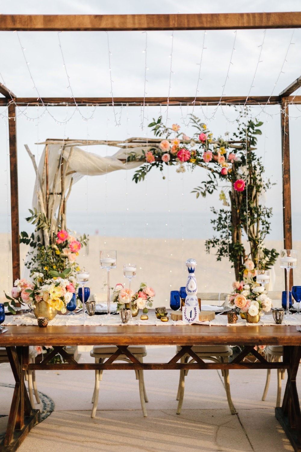 romantic sweetheart table idea with floral arch