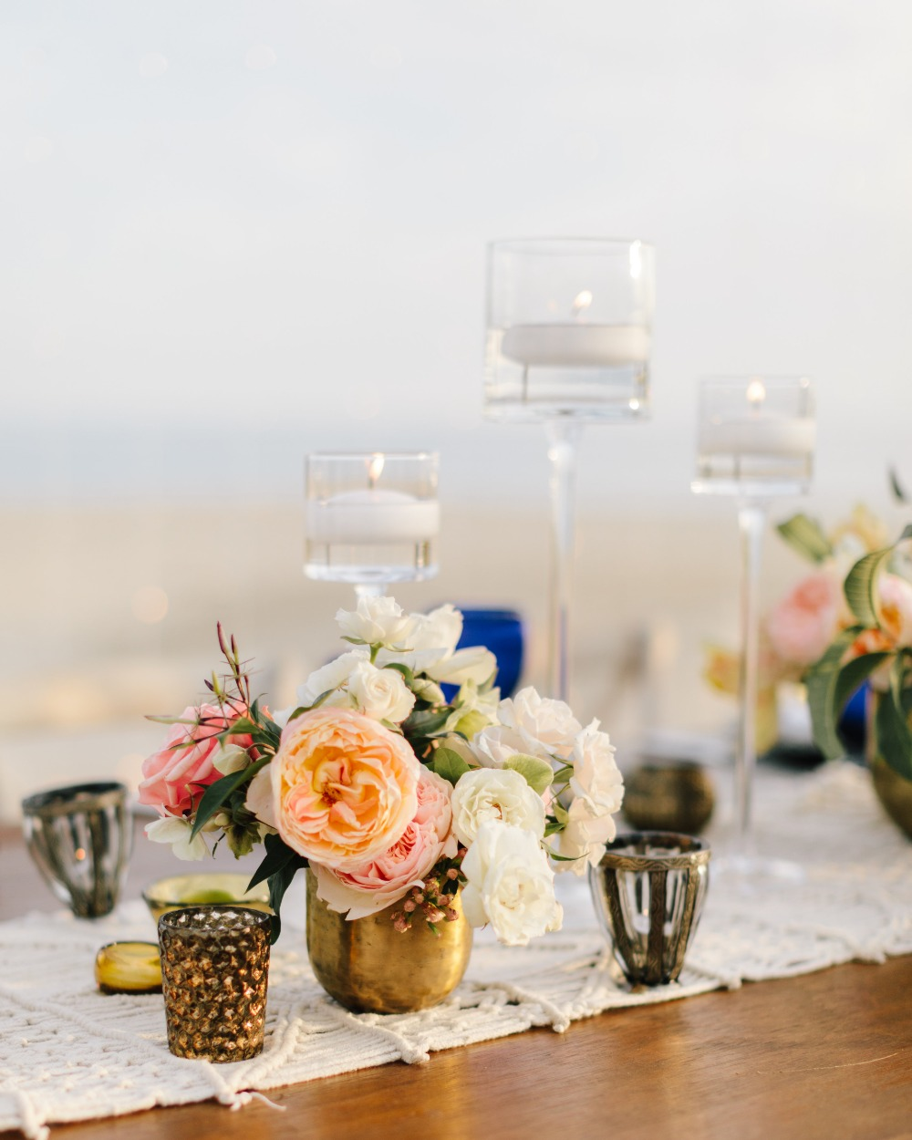 blush and gold centerpiece with floating candles