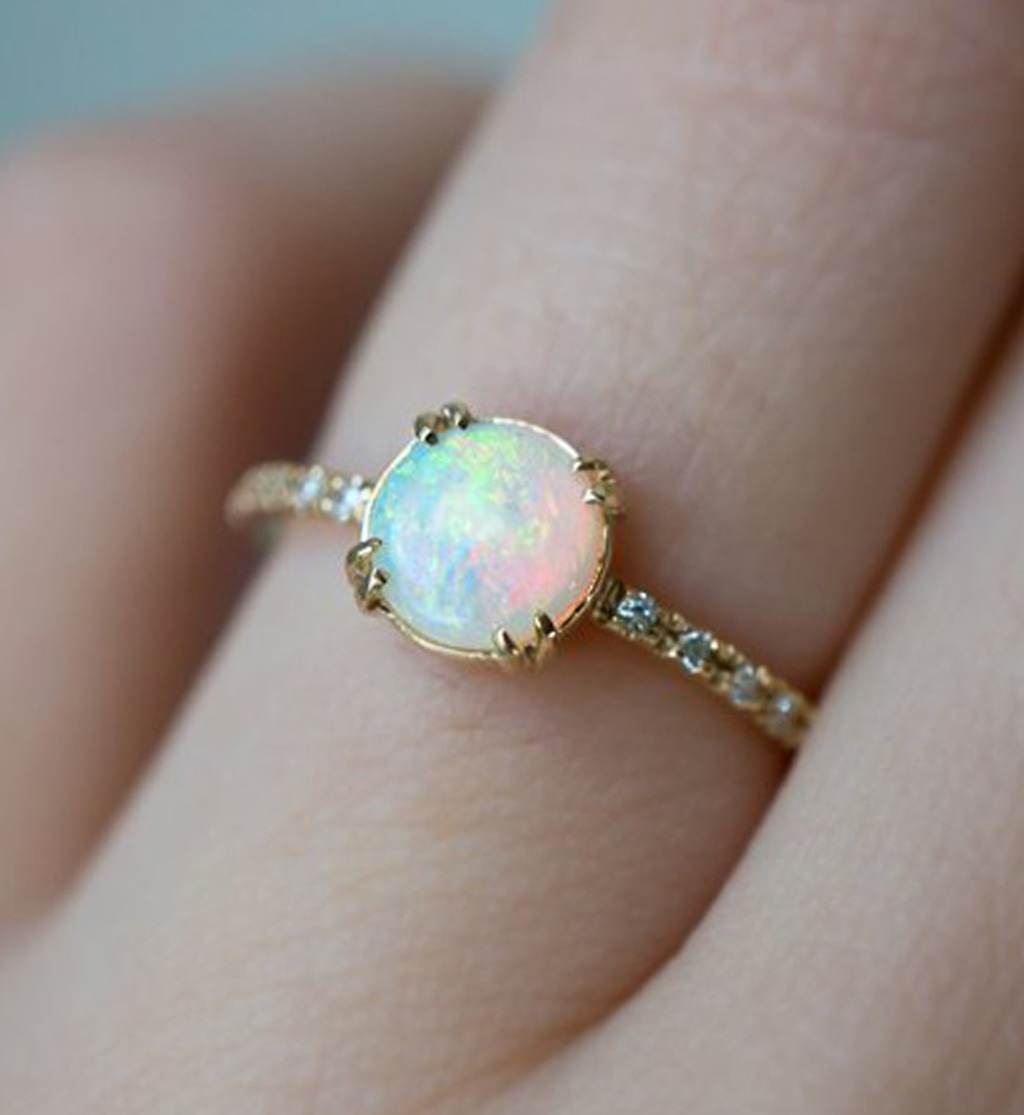 Each of our white Australian Opals is unique with pink, yellow, and blue flashes. Sitting flush to the finger, the low-profile design