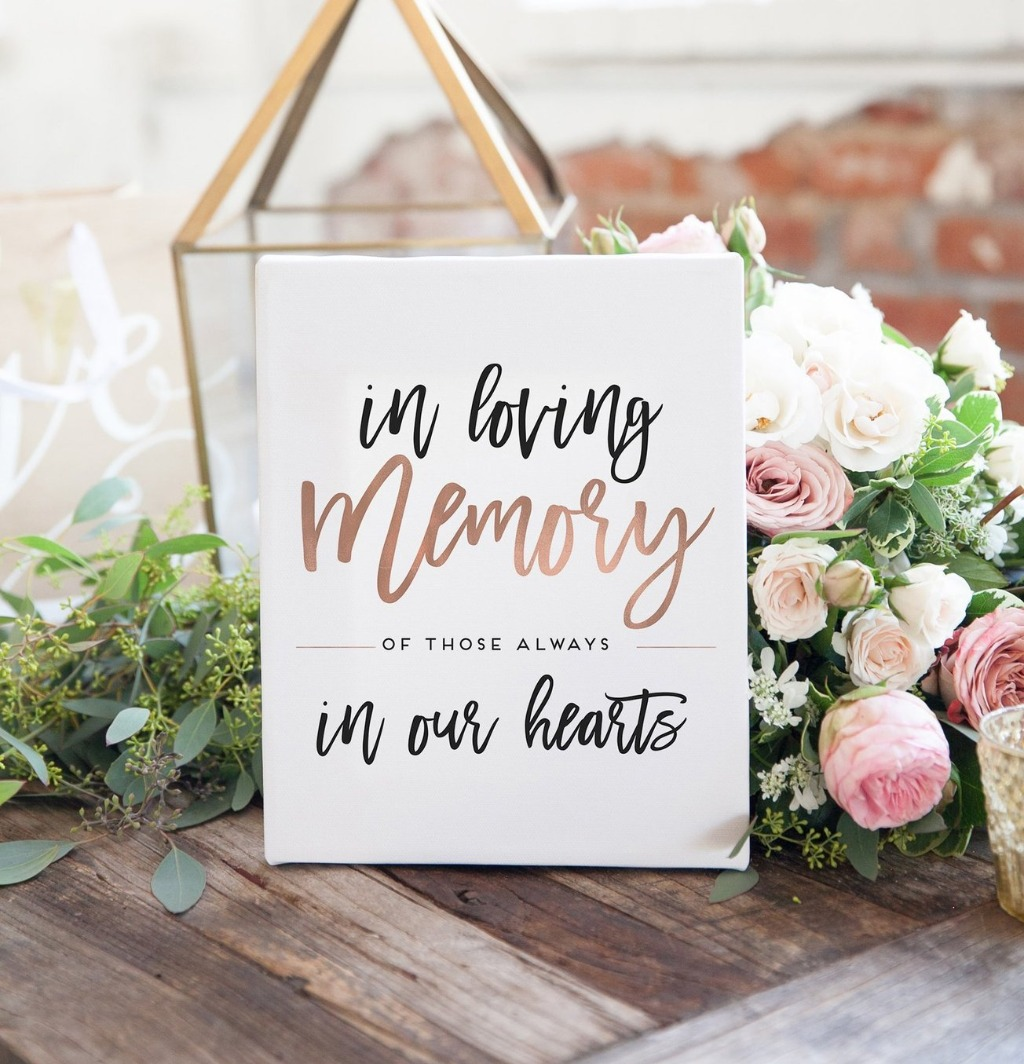 If you'd like to honor your passed loved ones on your big day, this In Loving Memory sign from Miss Design Berry is the perfect way