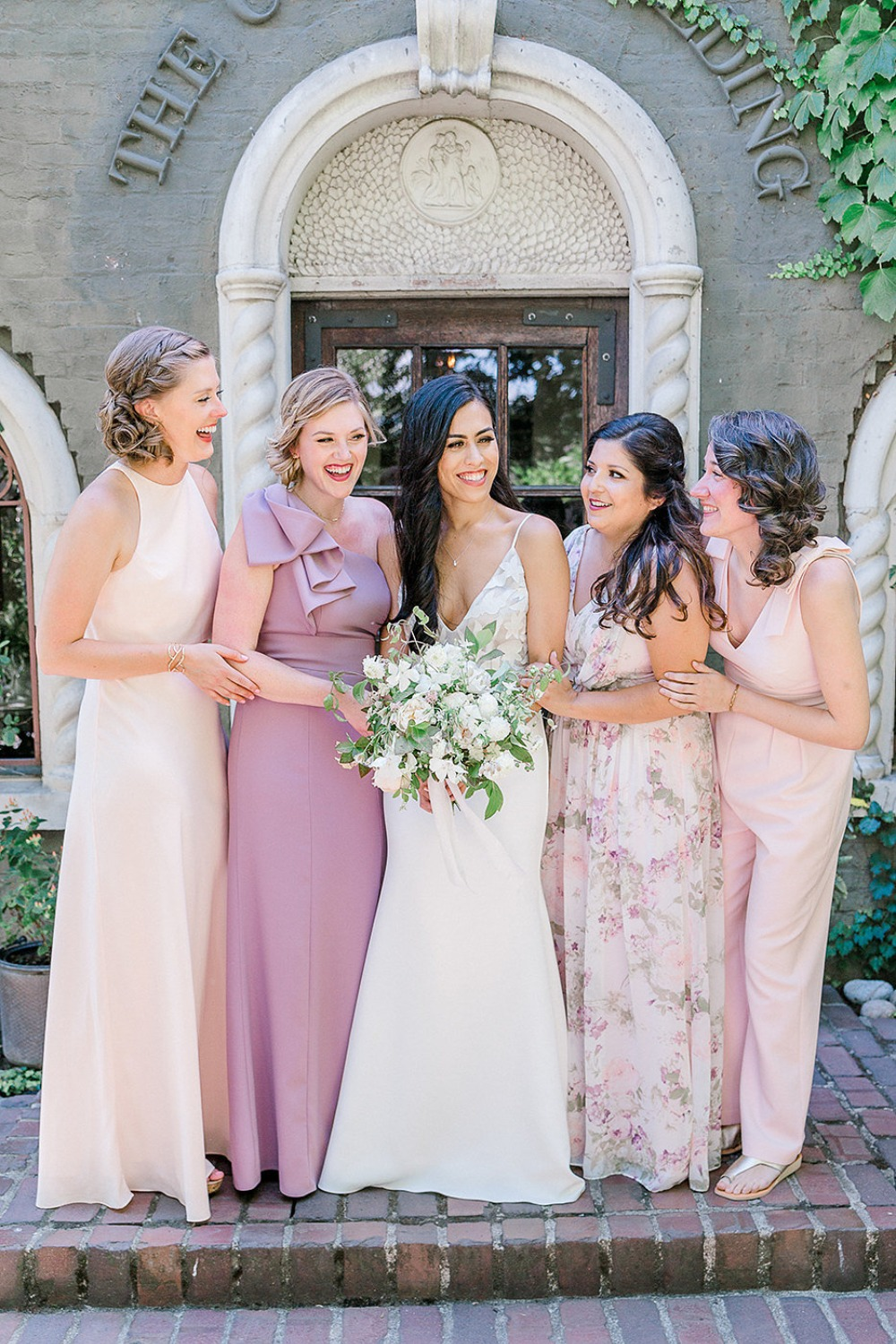 Bridesmaids in mismatched pinks