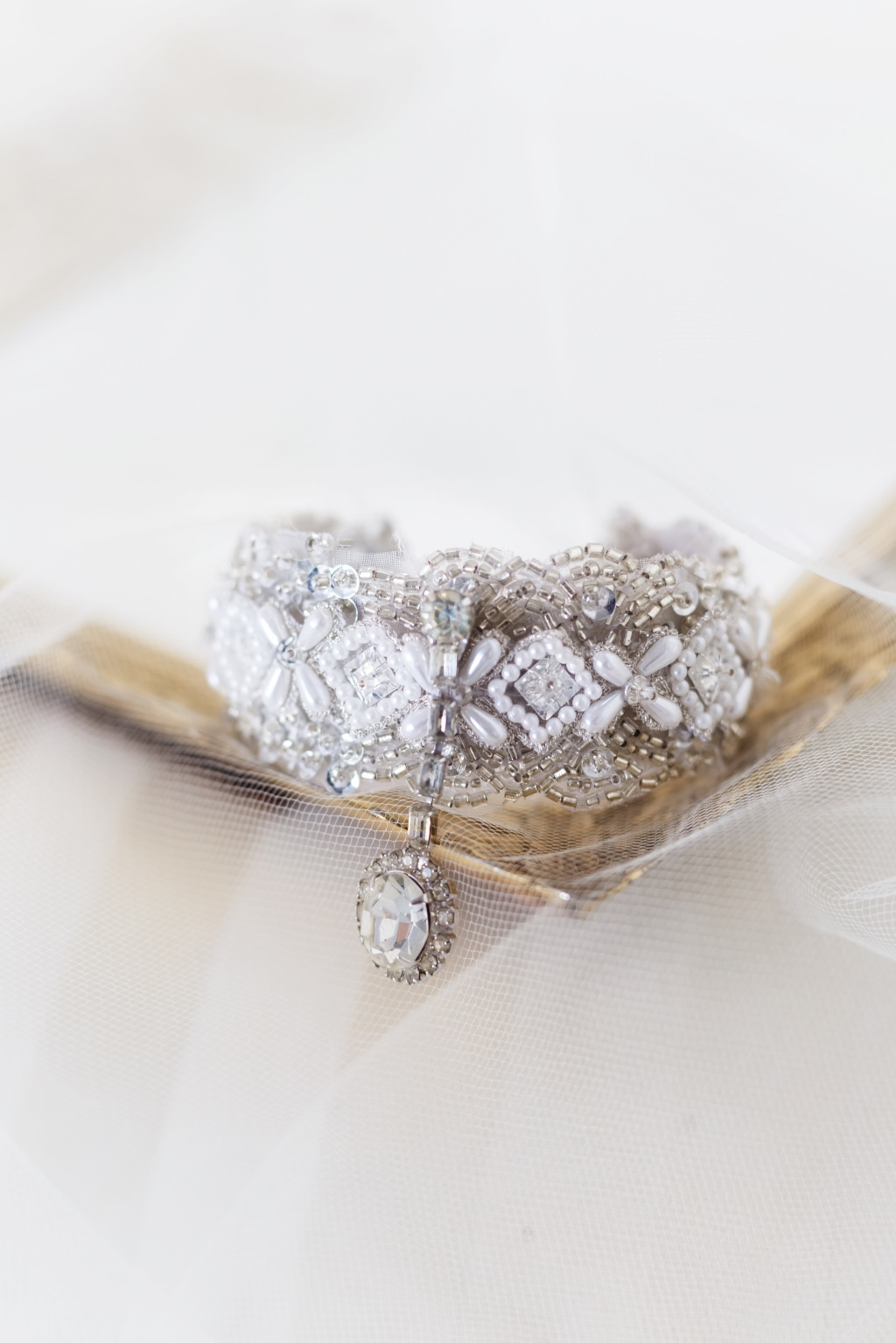 Small vintage jewels give this glamorous bridal cuff the prettiest sparkle.