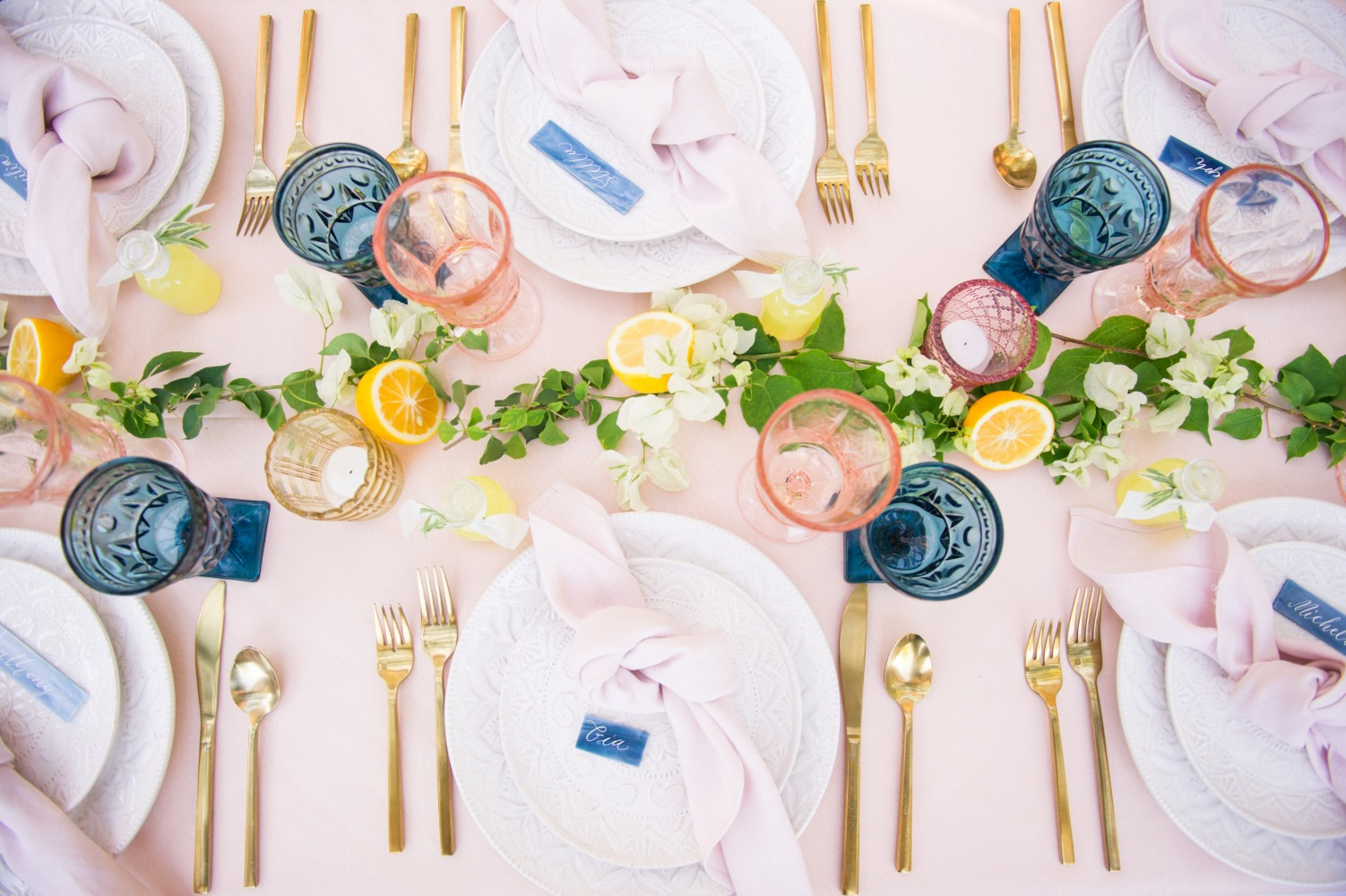elegant wedding table decor in pink blue and gold