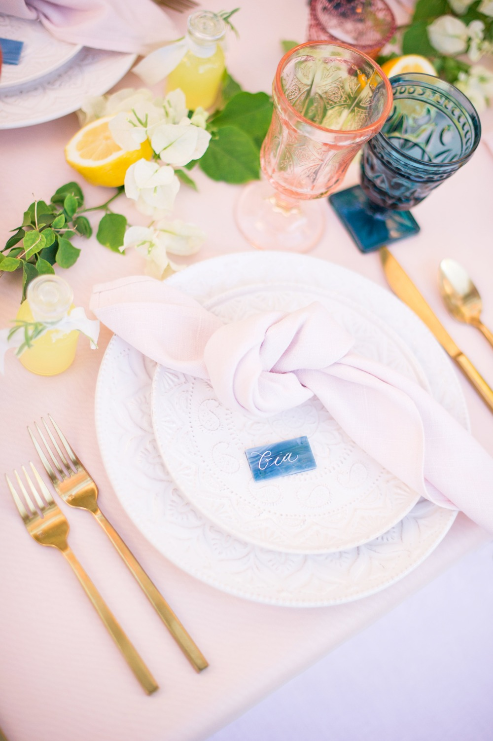 blue and pink and gold wedding place setting