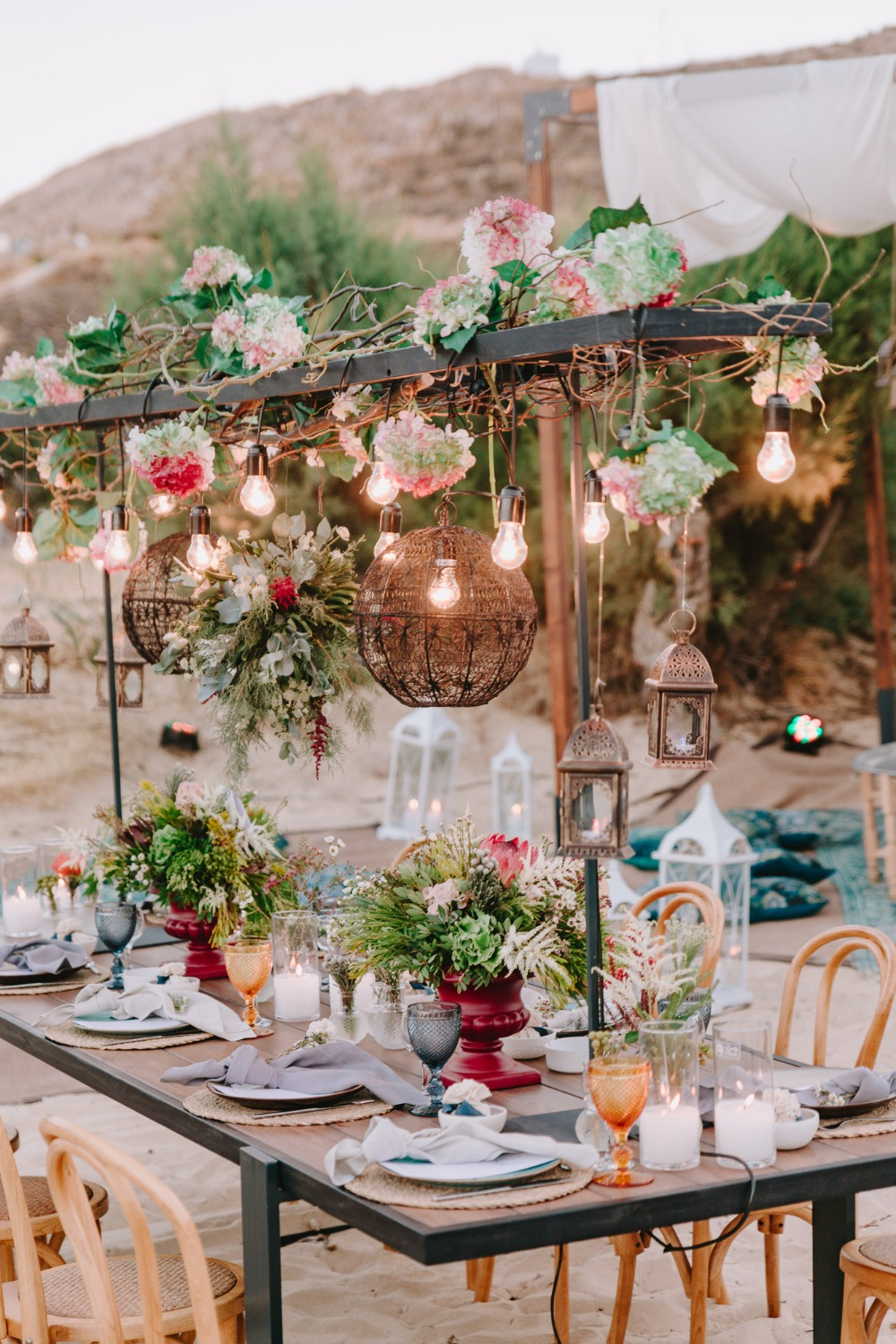 Wedding table decor idea with hanging lights