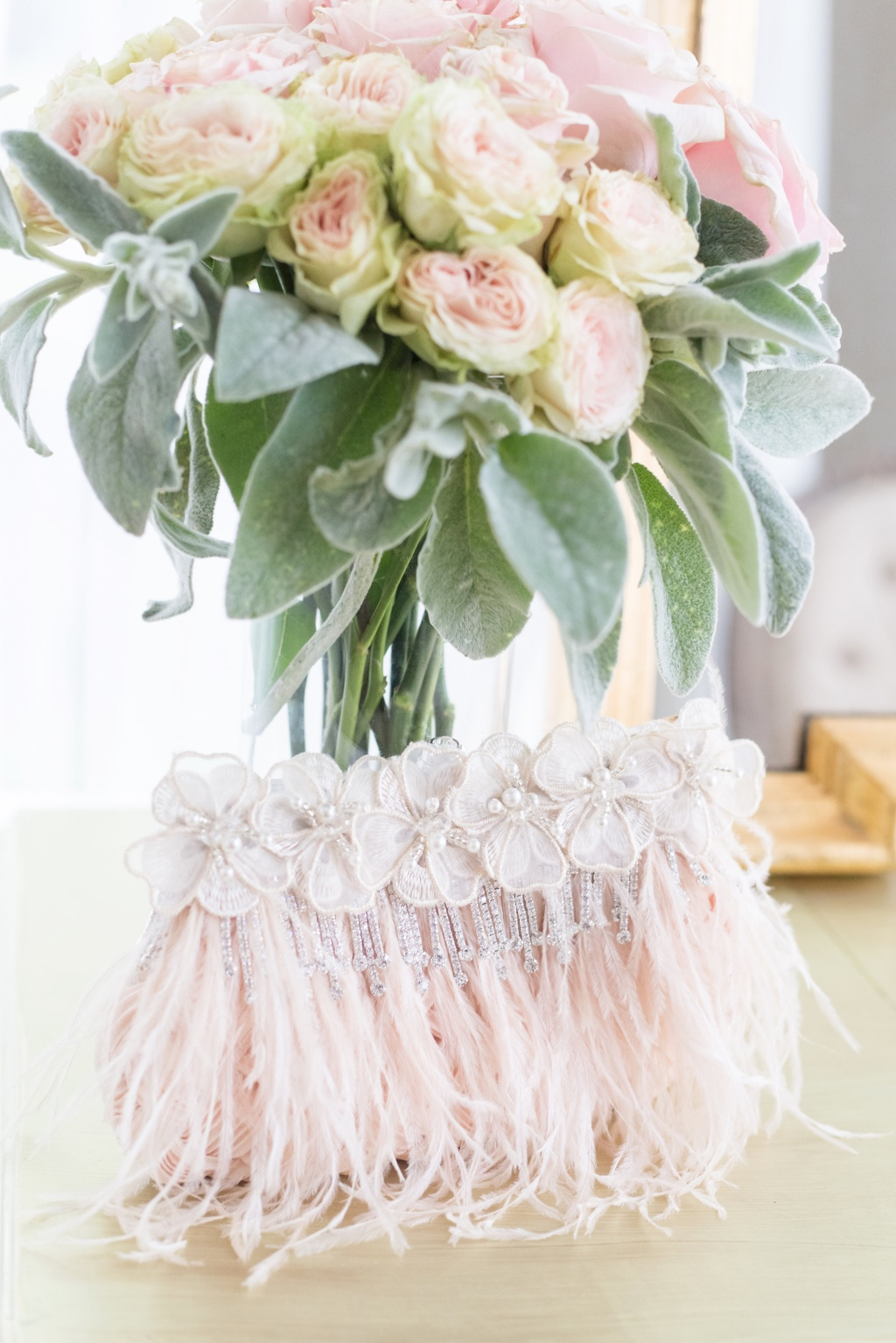 Blush feathers and rhinestone details are a must have for this glamorous bridal clutch