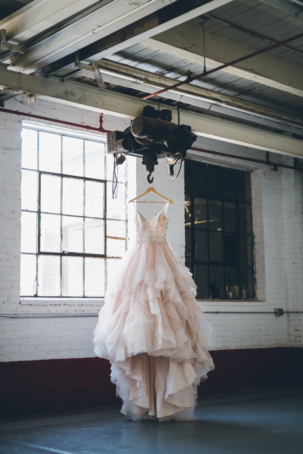 Grace + Ivory's Annette dress. Organza and tulle horsehair braid skirt. Blush with ivory accents. Hand-beaded top details. Every dress