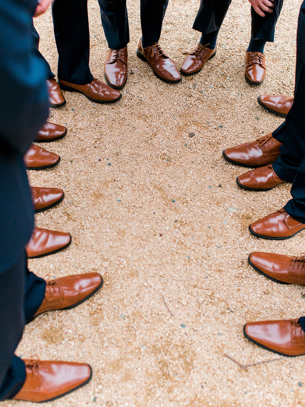 groomsmen in matching brown shoes