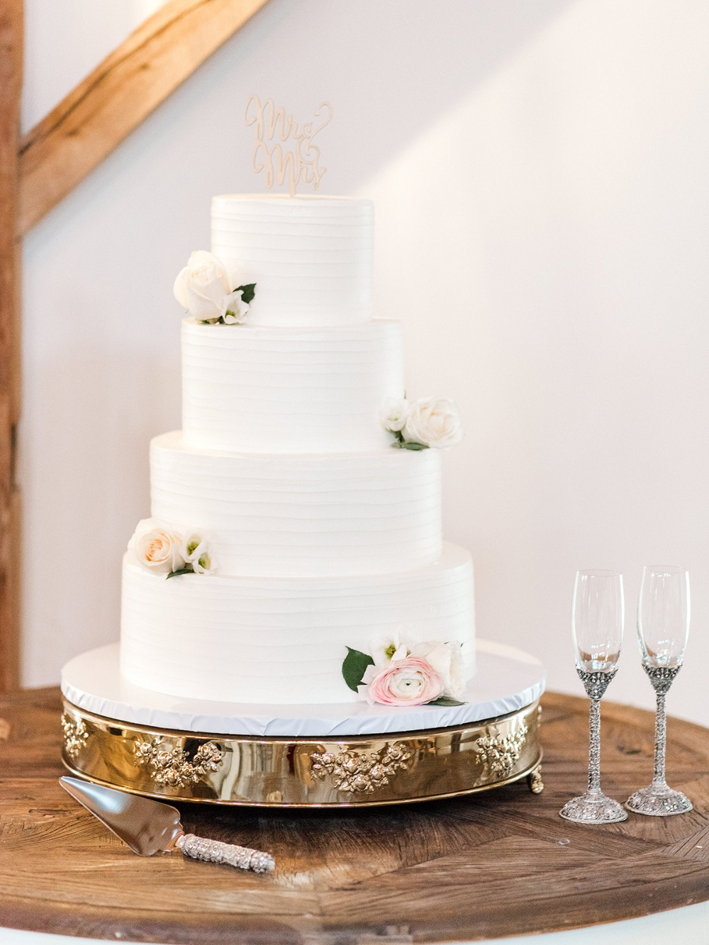 rose accented wedding cake