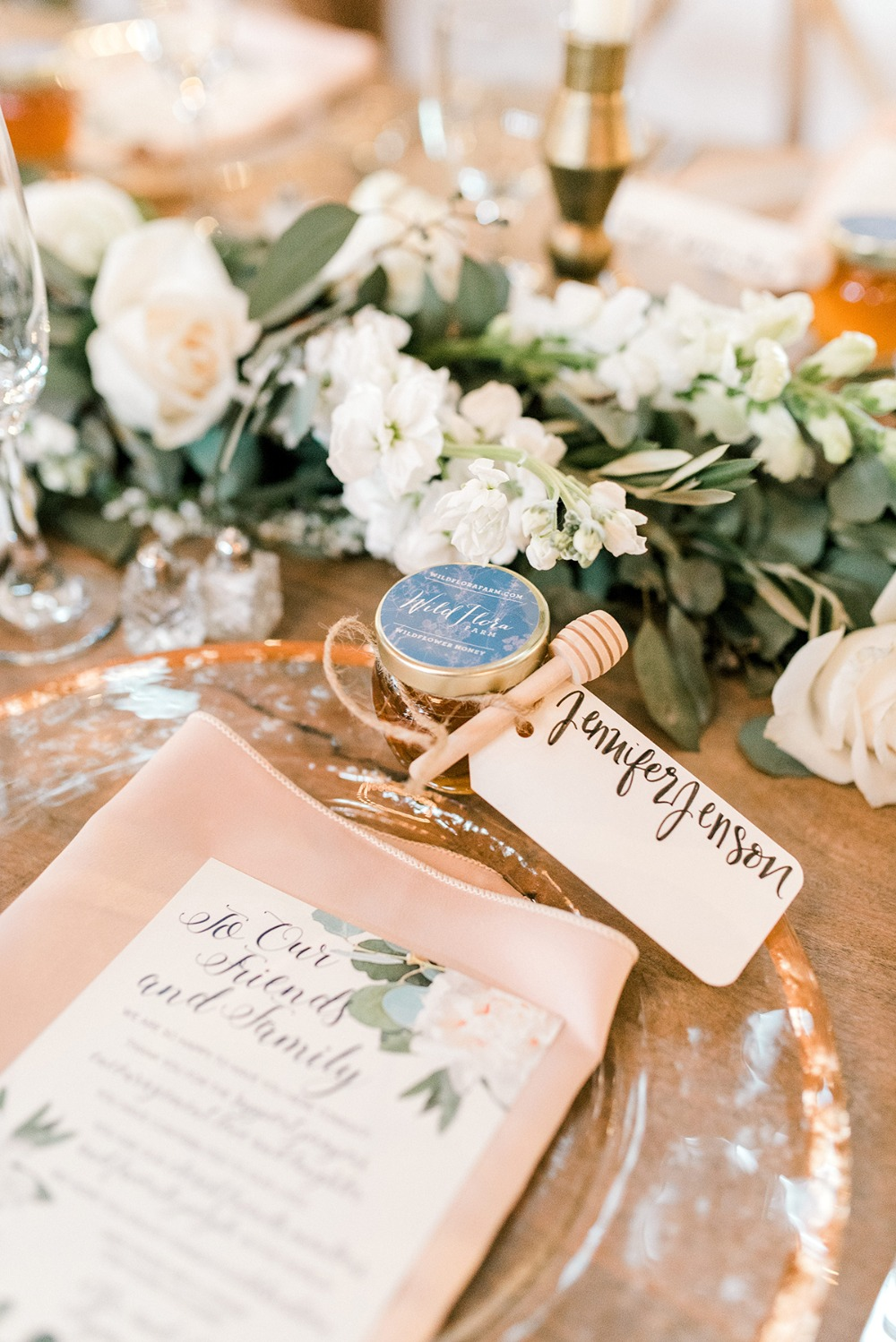 wedding place setting with a honey favor