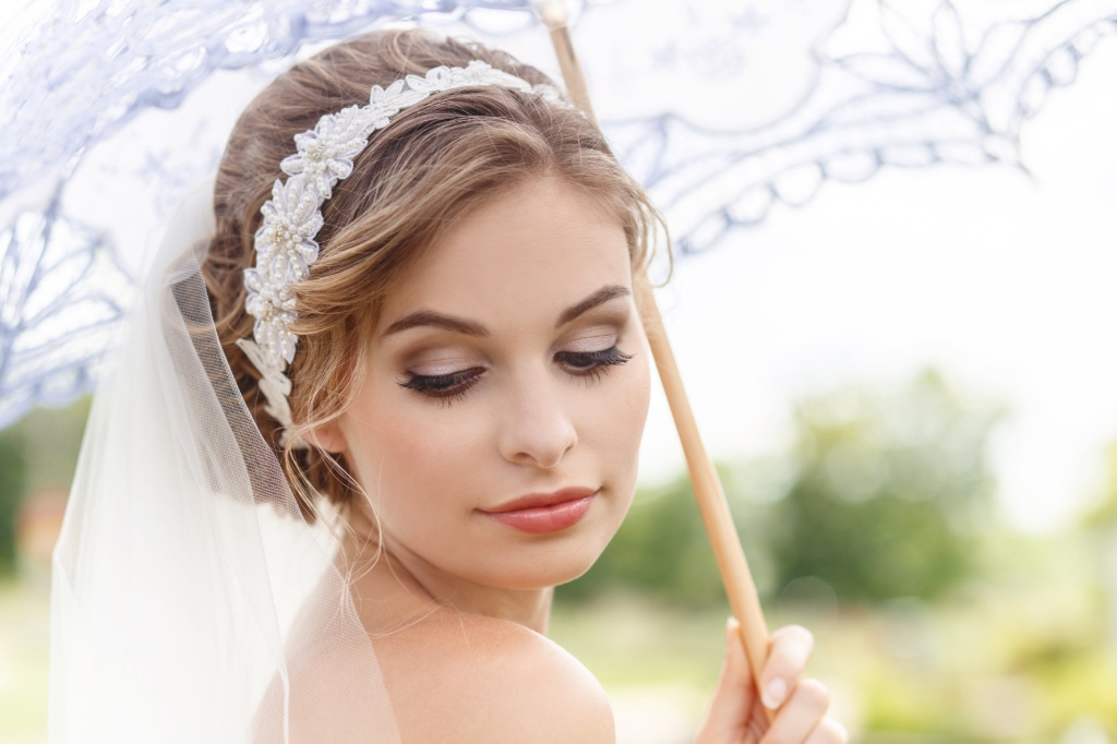 Pretty Ivory pearl flowers give this bridal headband all the classic bridal hair finishing touches