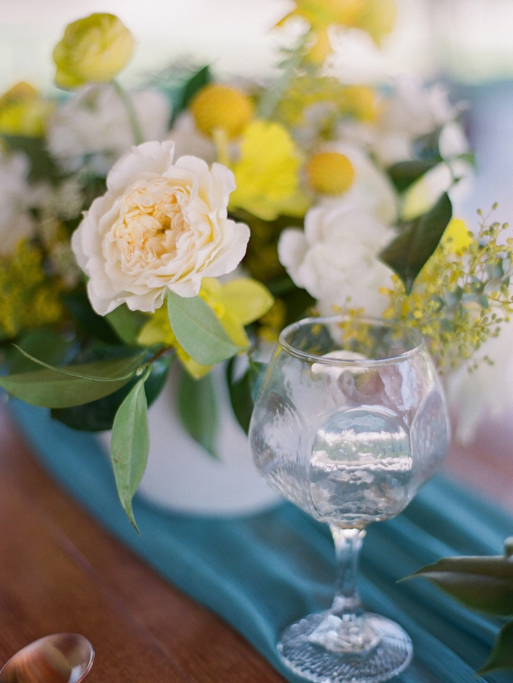 bright yellow white and teal wedding table