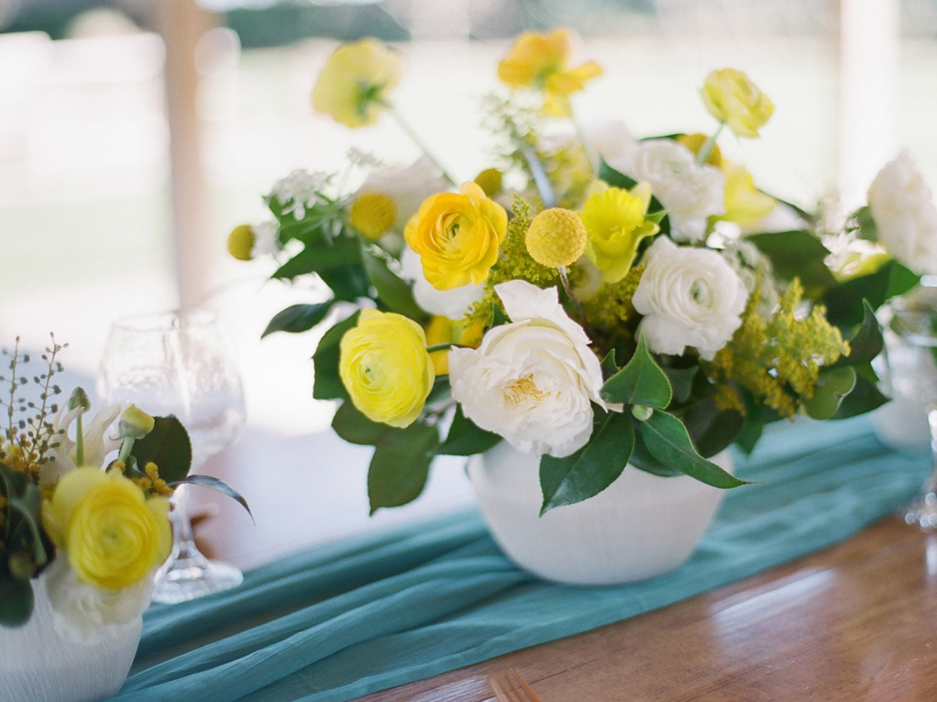 bight yellow and white wedding centerpiece